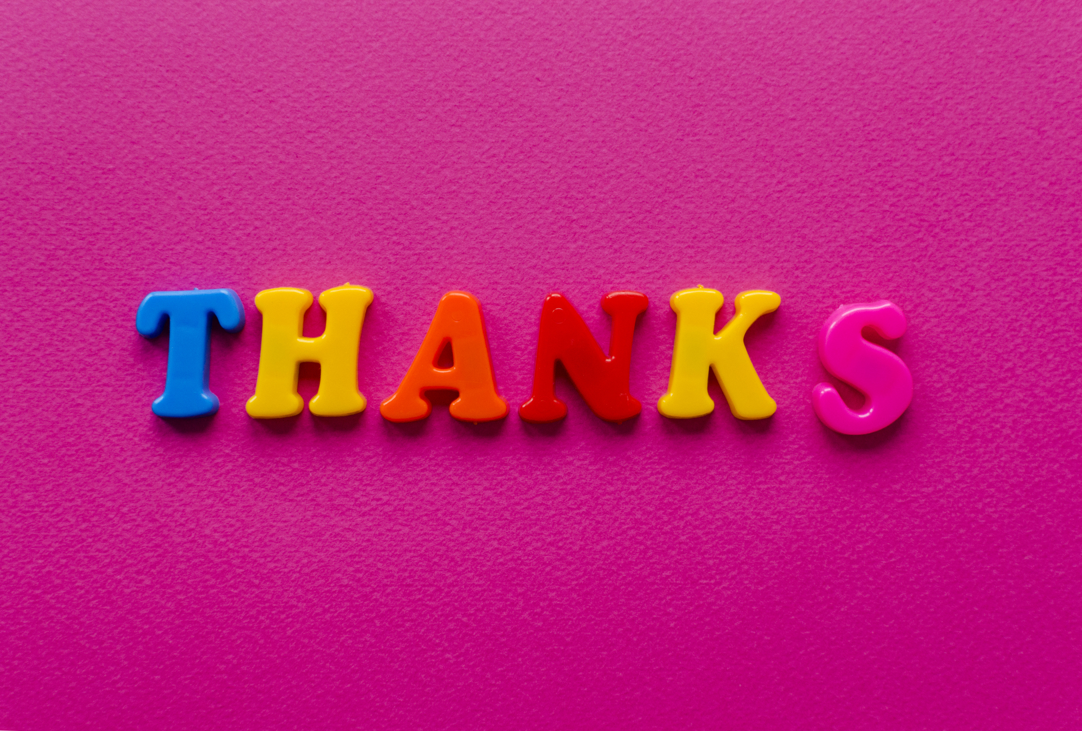"colored text ""Thanks"" on pink background"