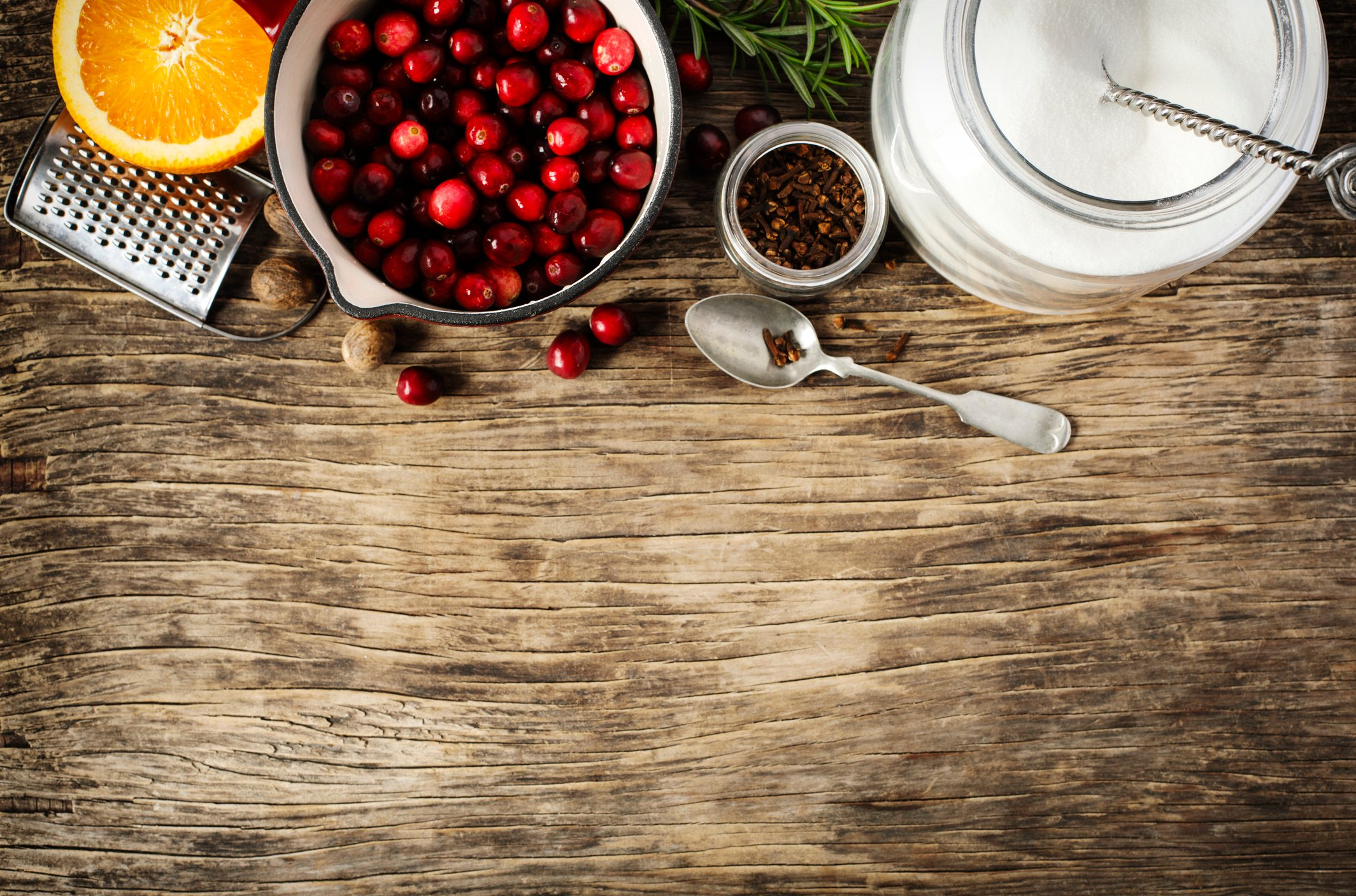Ingredients for cranberry sauce, top view, copy space