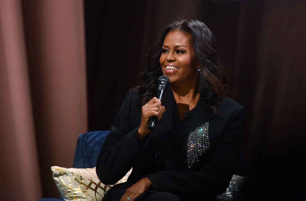 WASHINGTON, DC  NOVEMBER 17:  Former First Lady Michelle Obama chats with the audience  at the  Capitol One Arena on November 17, 2018 in Washington, DC  (Photo by Marvin Joseph/The Washington Post via Getty Images)