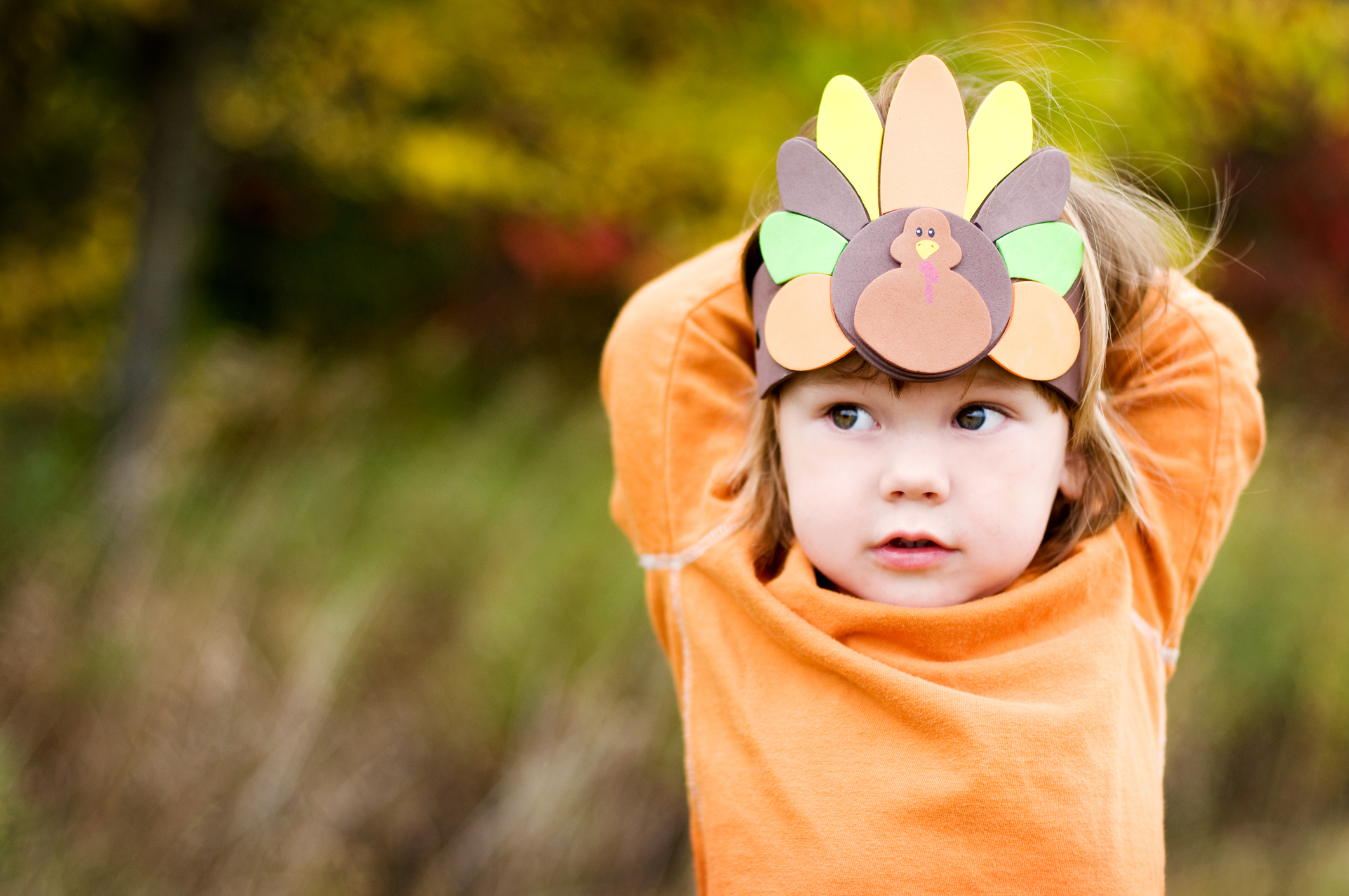 Little boy with a Turkey hat.  Focus on the hat.