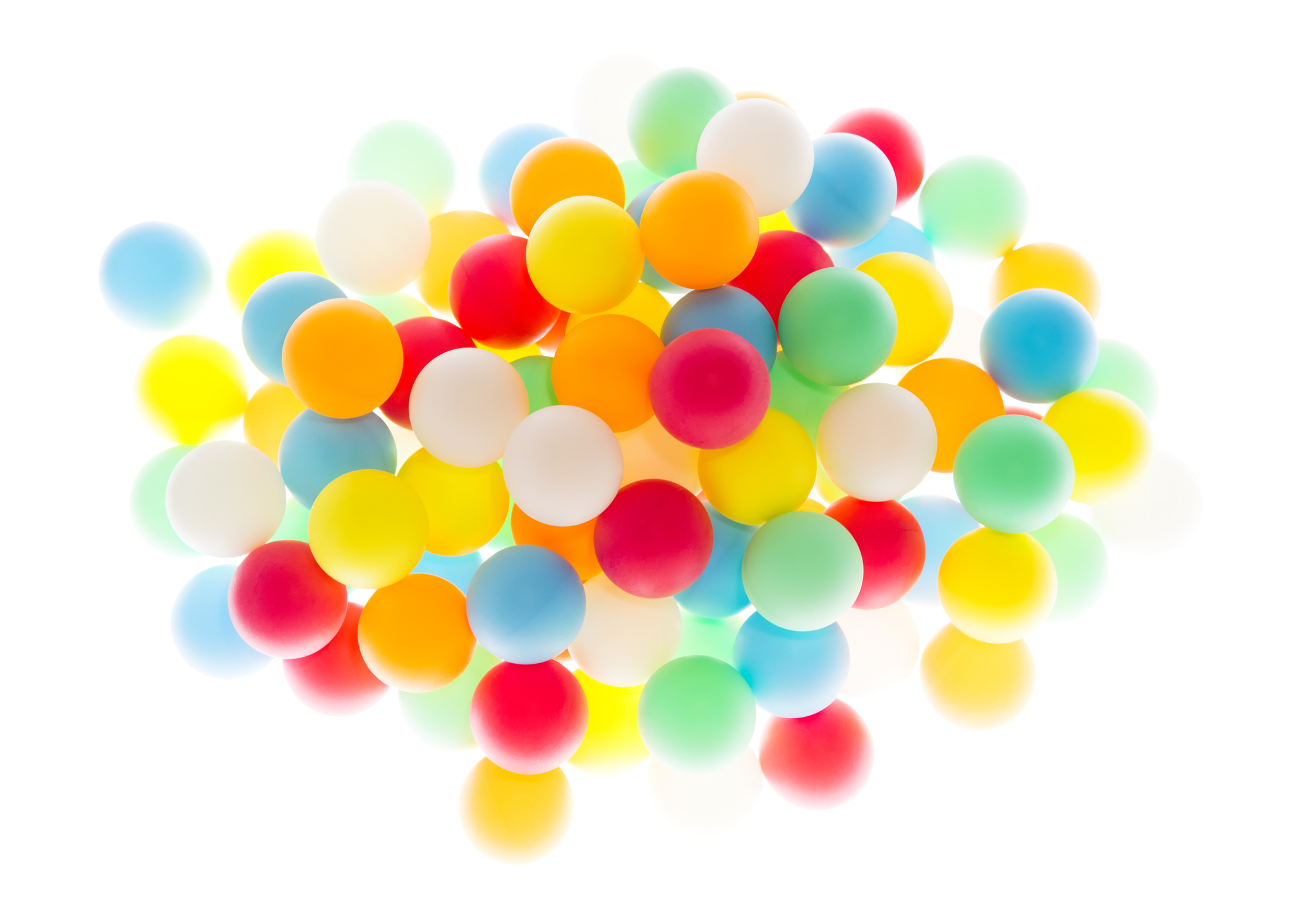 Tight cluster of multi colored spheres on high key white background