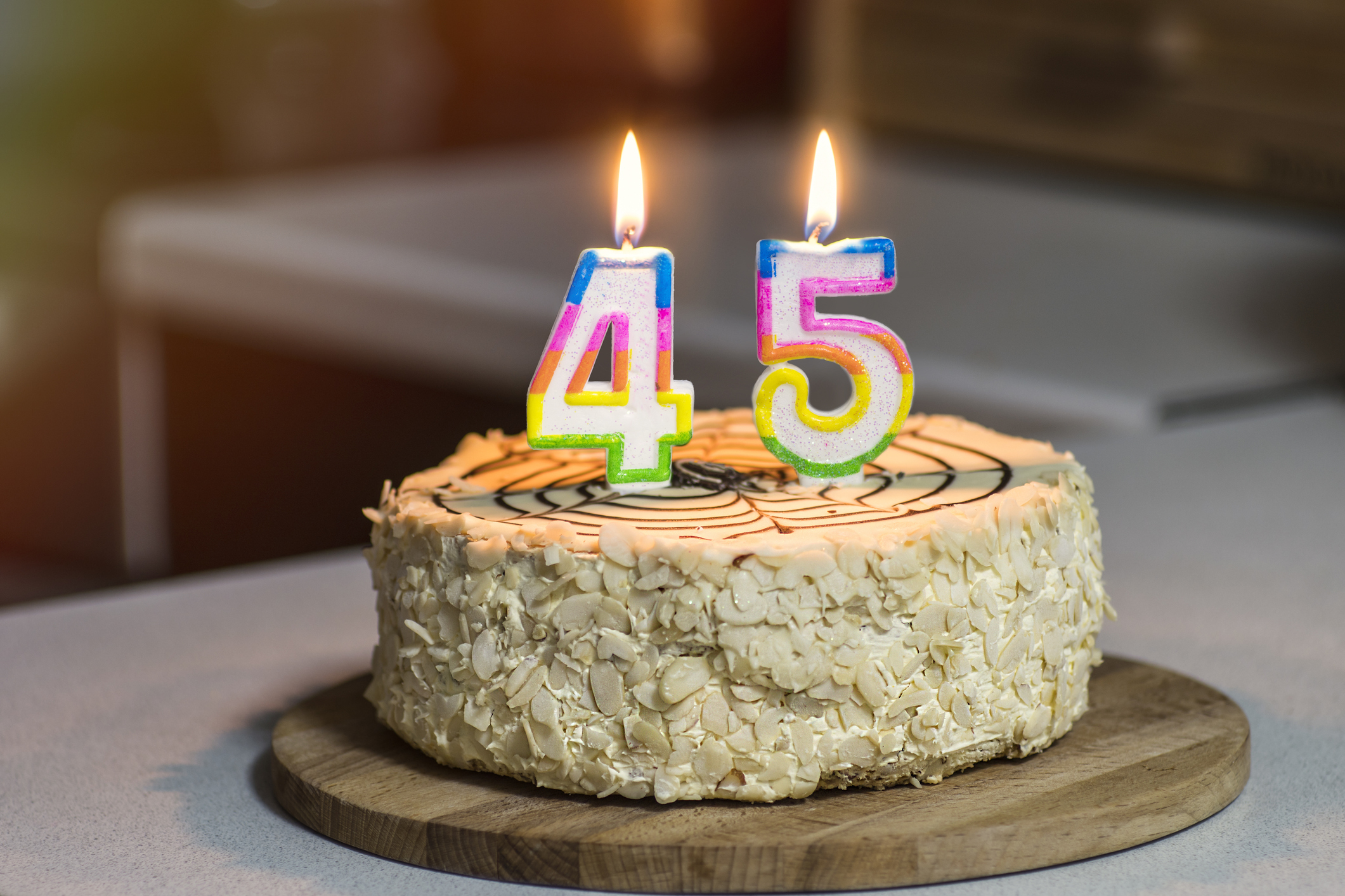 Birthday cake. Candles burn in the form of numbers 45.