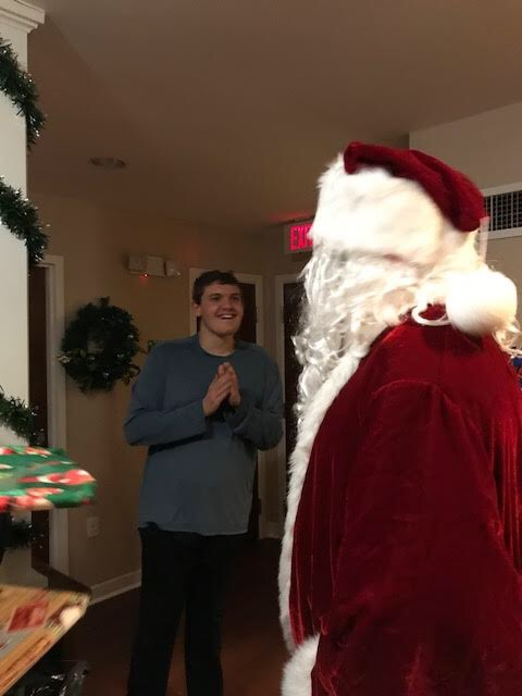 My son Joey enjoying a moment with Santa Claus at Anderson Center for Autism.