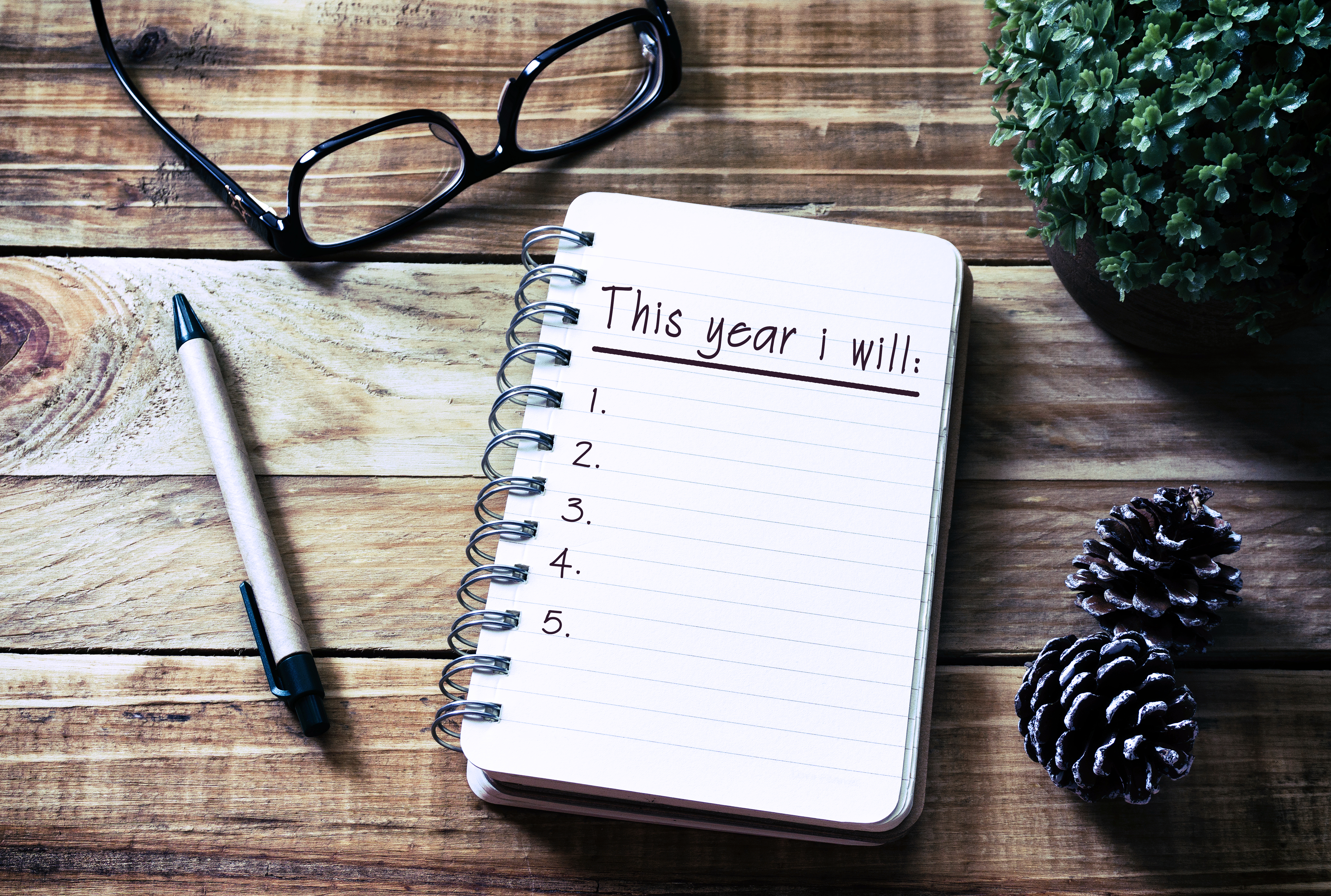 Notebook on wooden table with space to write goals