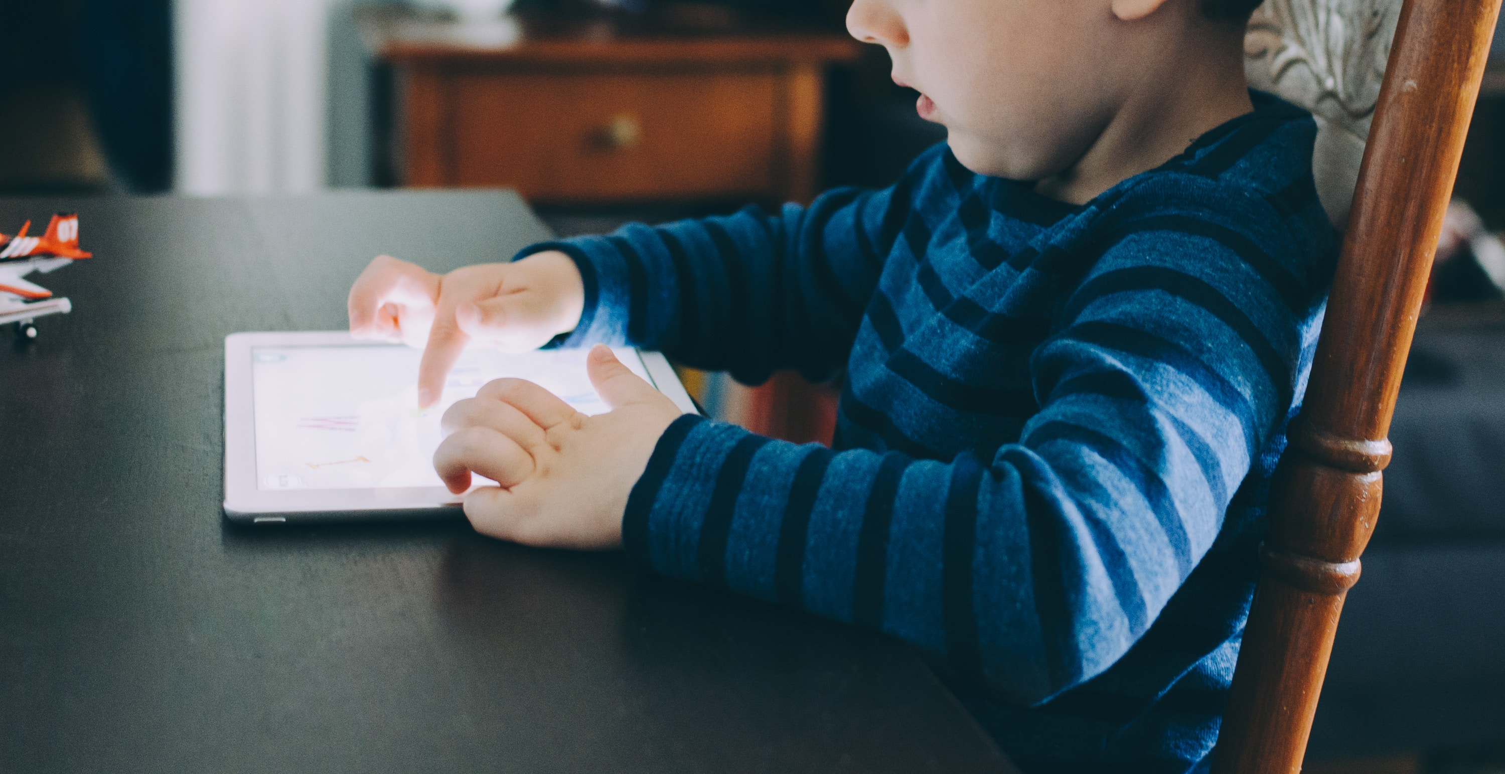 Boy playing on a tablet