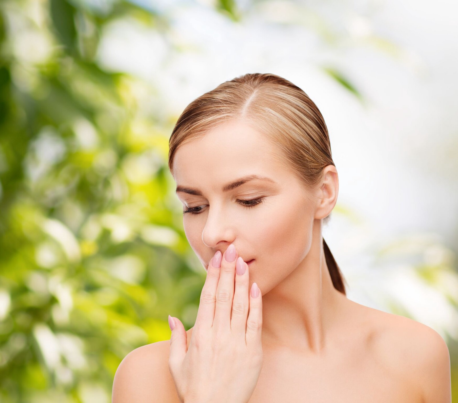 woman covering her mouth unable to tell the truth