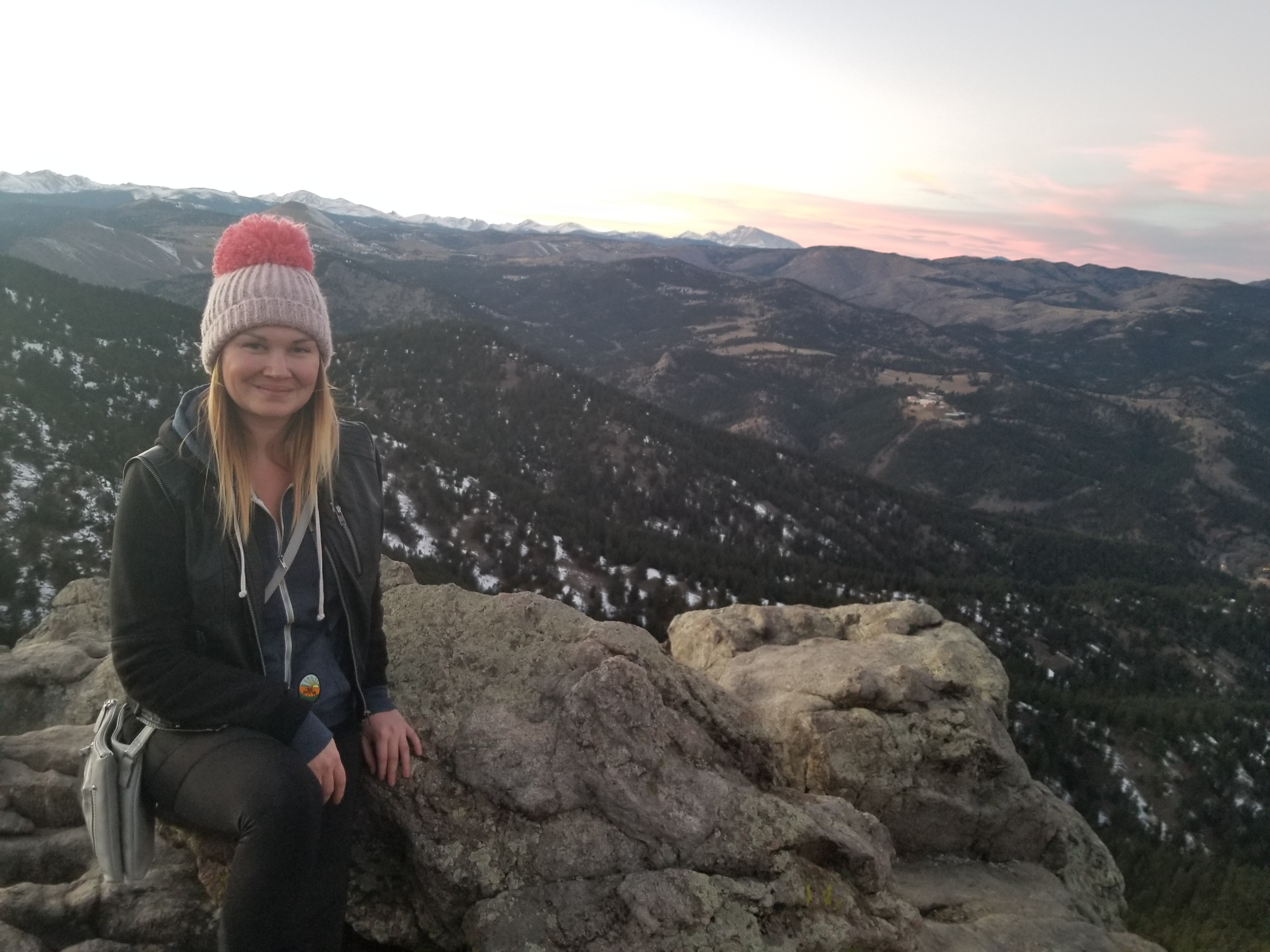 Me, quite literally facing my fear of heights after climbing to an epic lookout point in Boulder, CO.