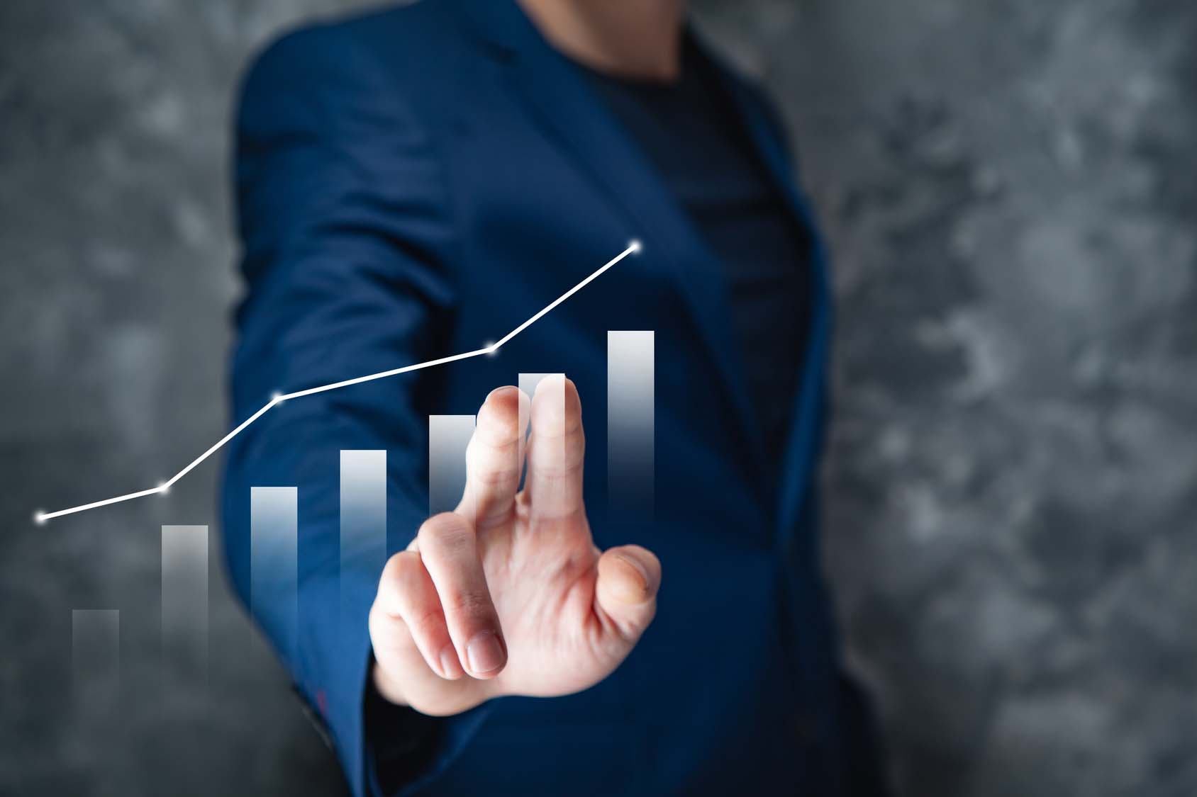 businessman touching graph in screen