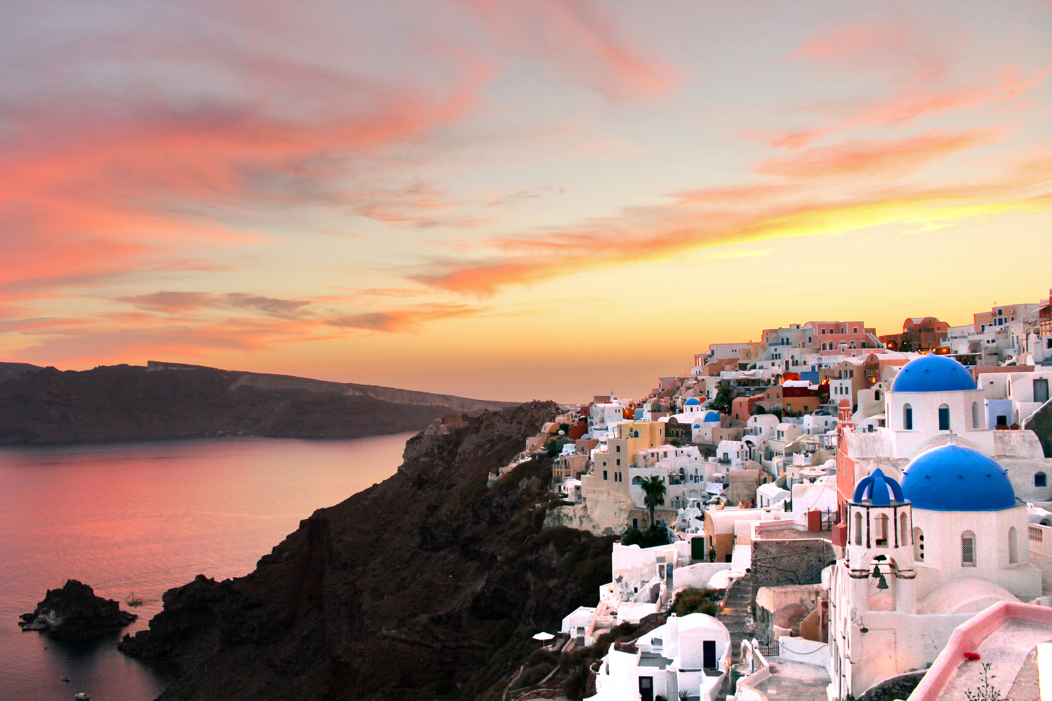 A landscape shot of one of the most famous sightseeing spots in Greece, right after the sunset. You can see the traditional whitewashed houses and the beautiful colors of the sunset at this special location.