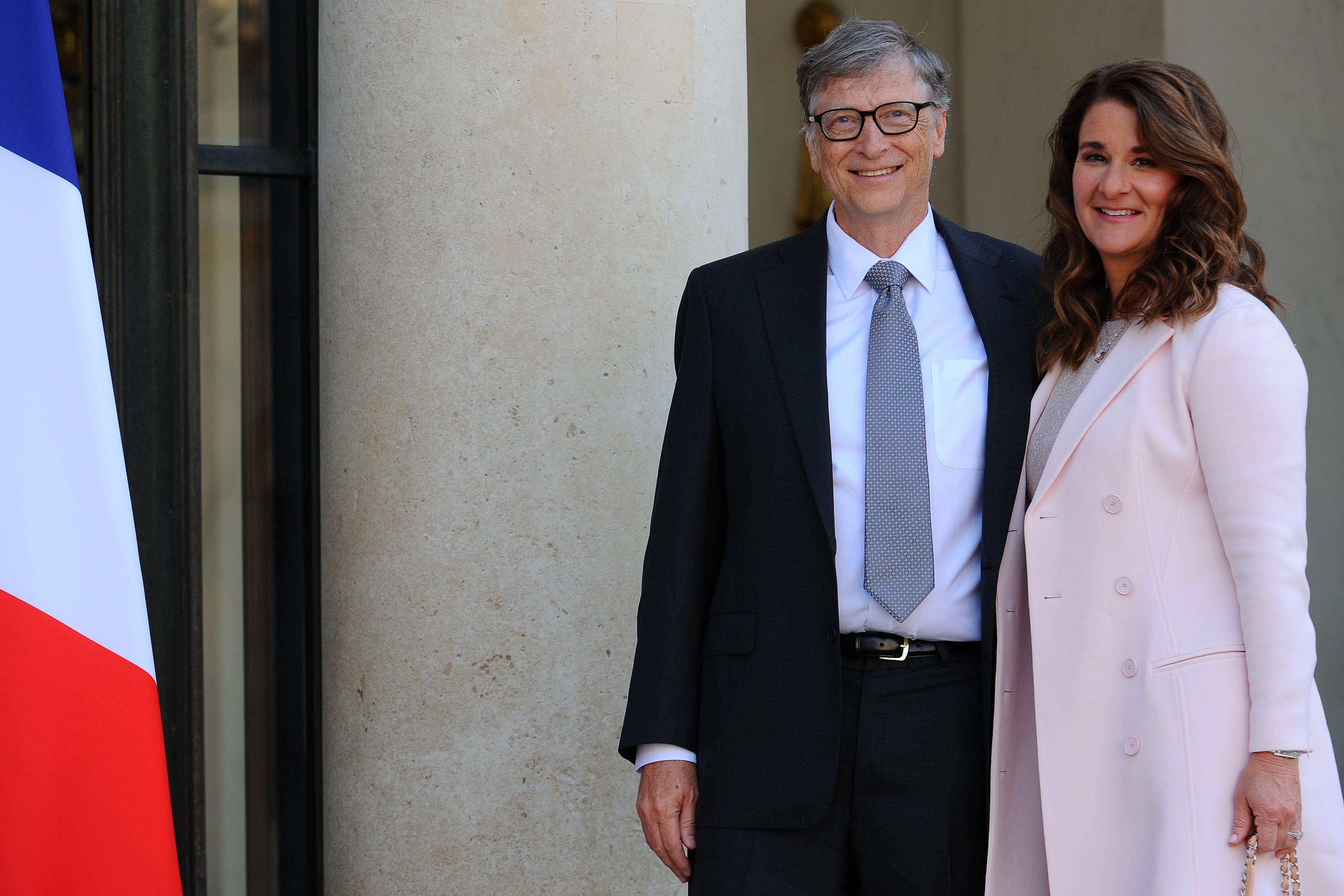 PARIS, FRANCE - APRIL 21: Bill and Melinda Gates pose in front of the Elysee Palace before receiving the award of Commander of the Legion of Honor by French President Francois Hollande on April 21, 2017 in Paris, France. French President Fran?ois Hollande awarded the Honorary Commander of the Legion of Honor to Bill and Melinda Gates as the highest national award under the partnership between France and the Bill & Melinda Gates Foundation, which have been unavoidable actors for several years Of development assistance and health in the world. (Photo by Frederic Stevens/Getty Images)