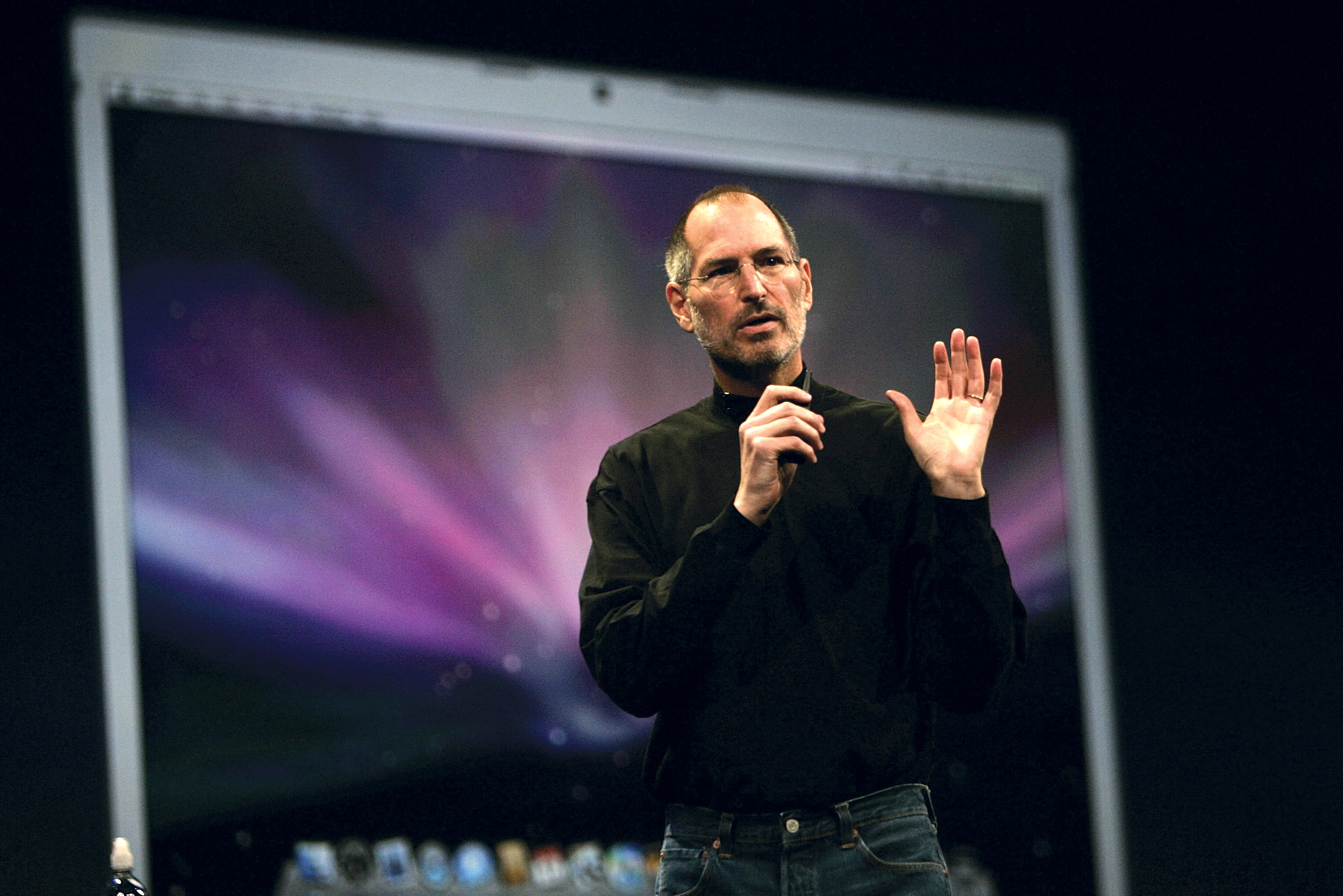 SAN FRANCISCO - JANUARY 15:  Apple CEO and co-founder Steve Jobs delivers the keynote speech to kick off the 2008 Macworld at the Moscone Center January 15, 2008 in San Francisco, California. Jobs introduced the wireless Time Capsule backup appliance, Apple TV Take 2 and the new ultra thin laptop MacBook Air.  (Photo by David Paul Morris/Getty Images)