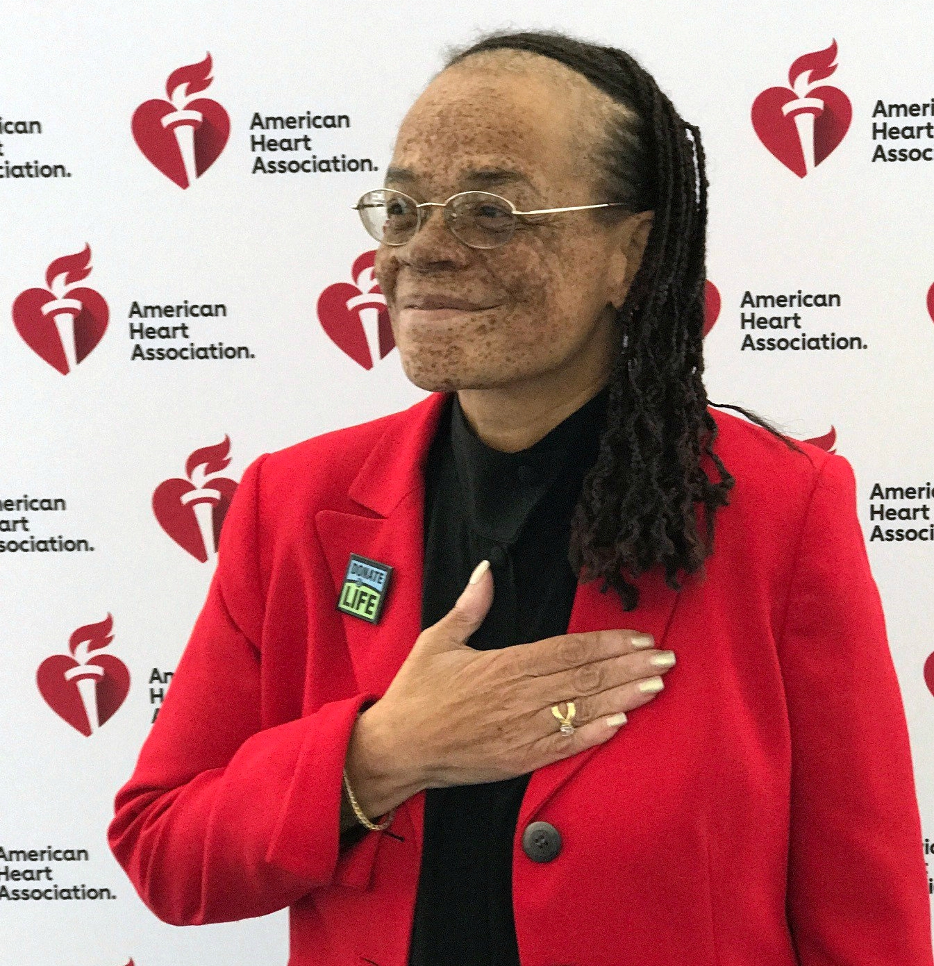 Roxanne Watson places a hand over her new heart.