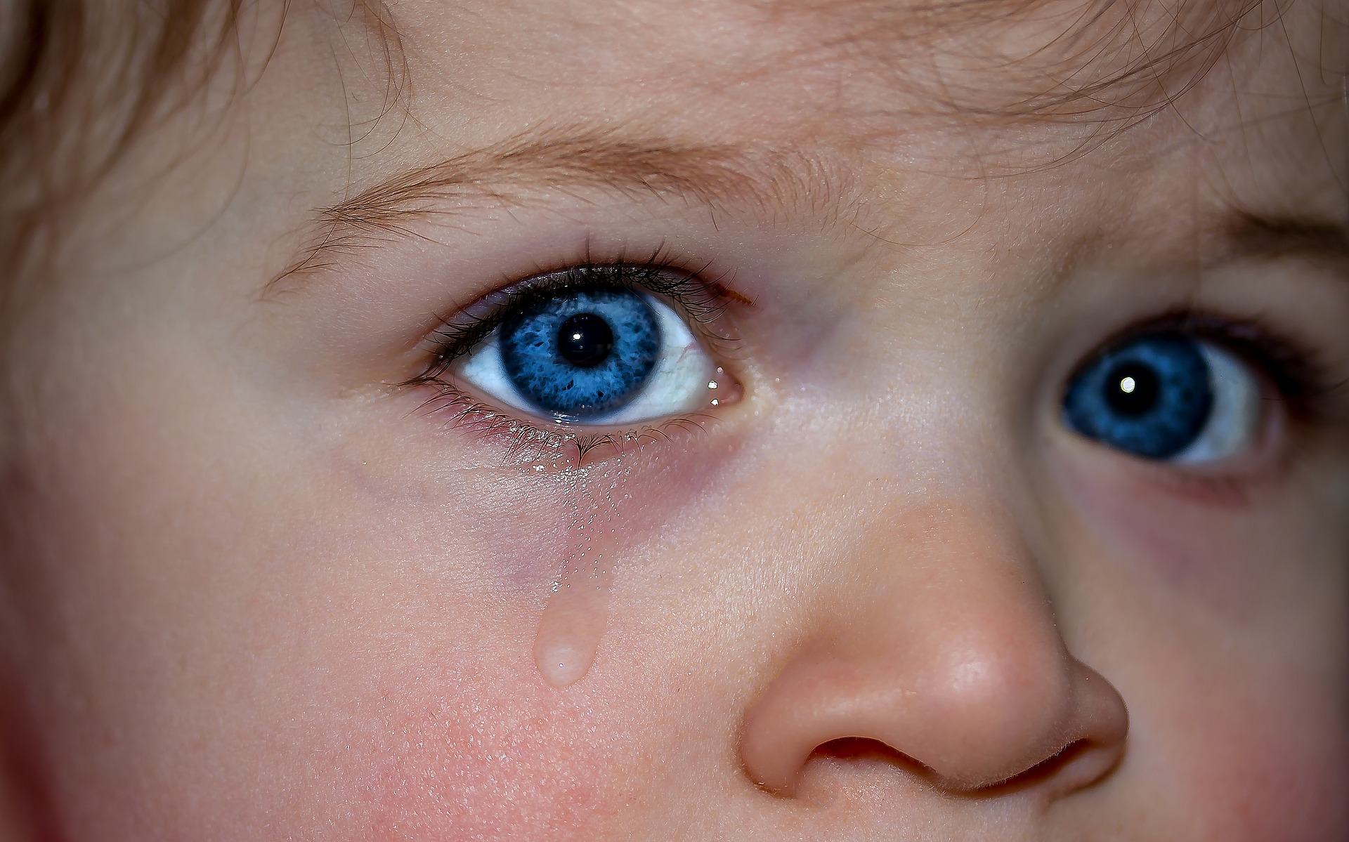 Teary-blue-eyed child.