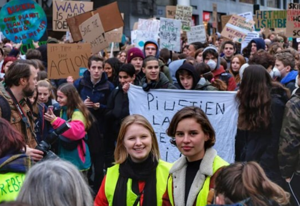 Organizers Kyra Gantois, 19, and Anuna De Wever, 17, at Brussels school strike on January 10, 2019 with over 3,500 marchers. The movement is growing. Earlier this month, the Brussels march included over 12,000 students. (Credit: Instagram)