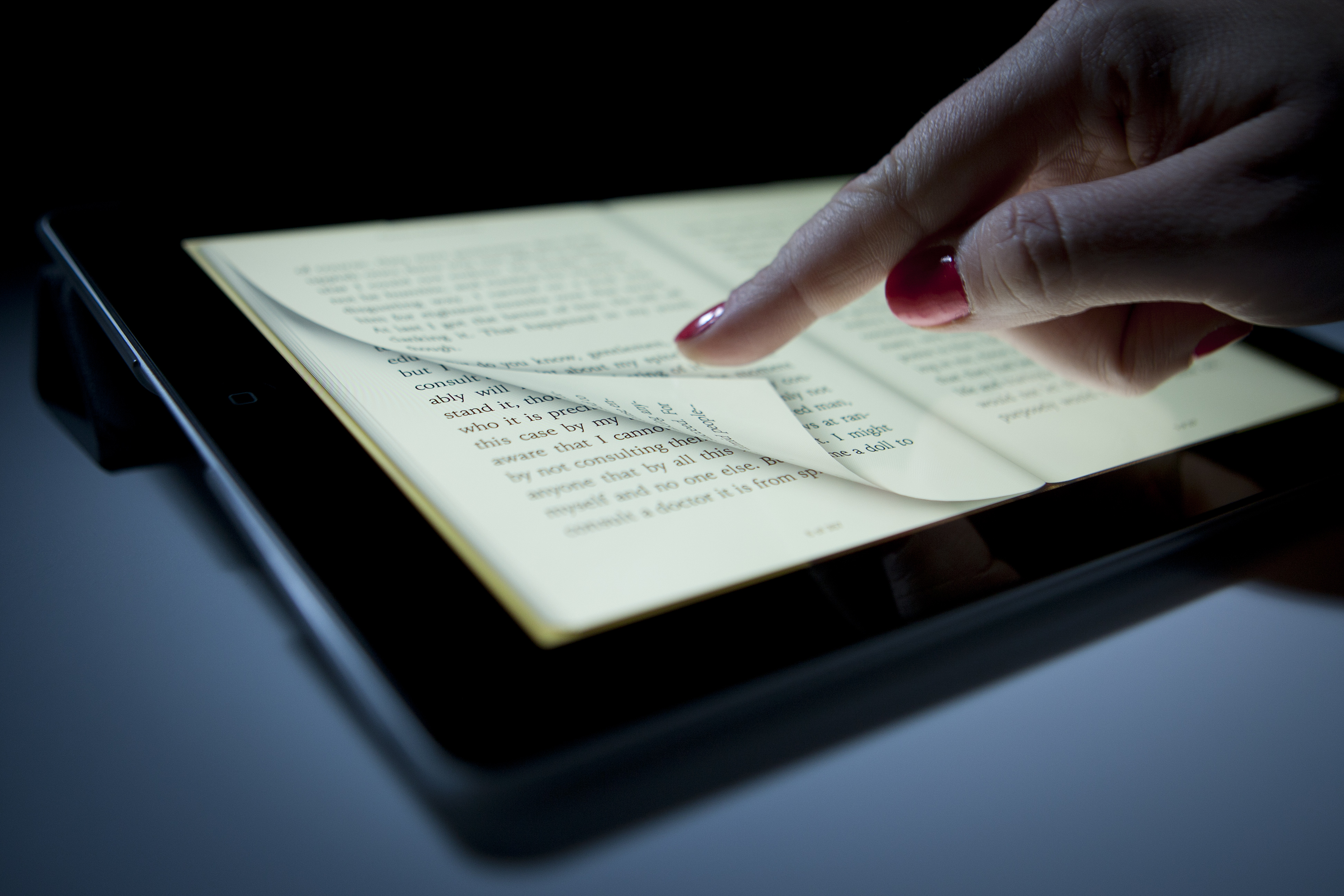 Woman reading on a digital device