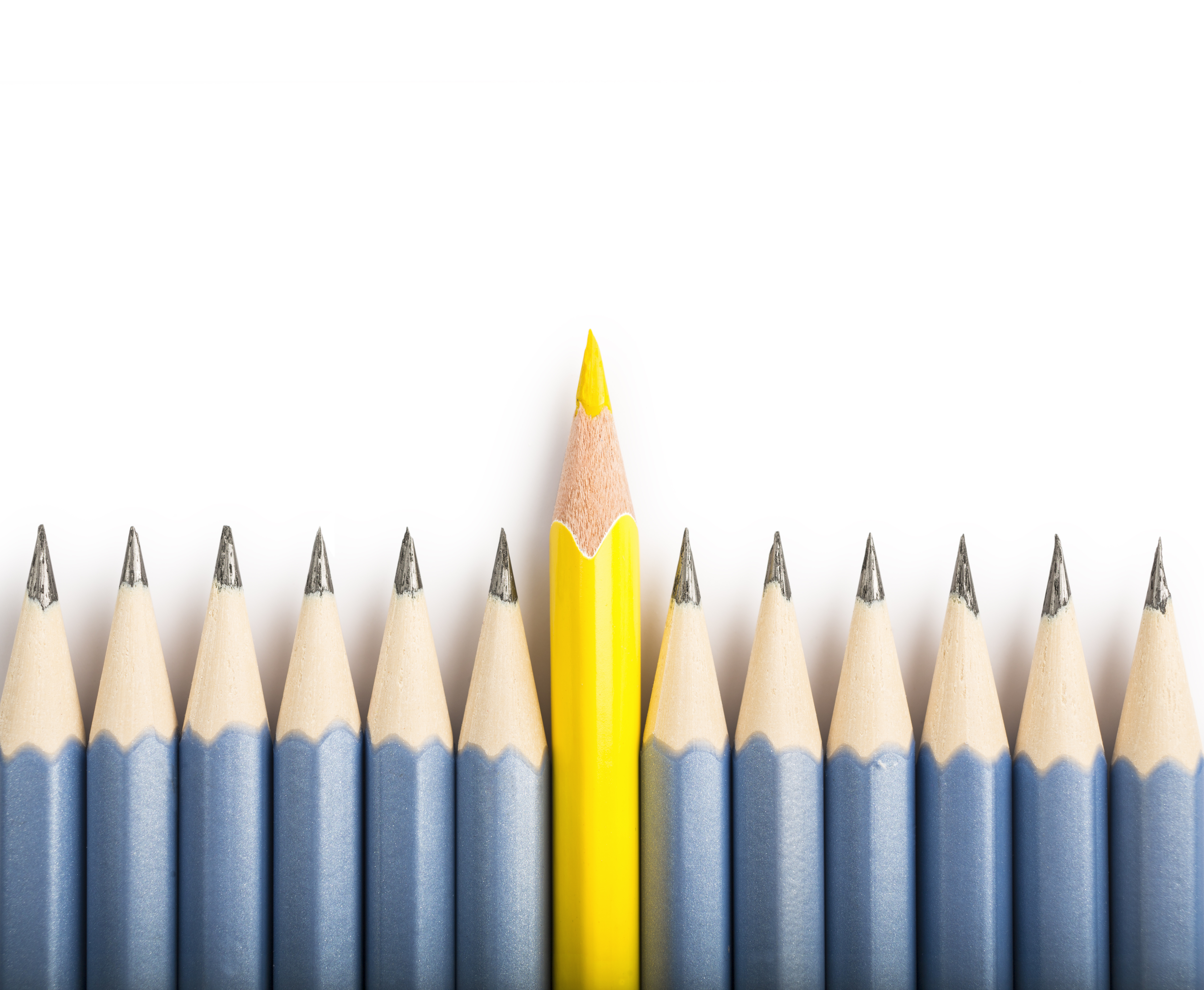 View directly from above of a group of pencils in which a yellow pencil differs from the others and stands out from the crowd. Concept of individual, standing out from the crowd and business purposes. The crayons are nicely isolated on a white background, with a natural shadow (studio shot in macro mode).