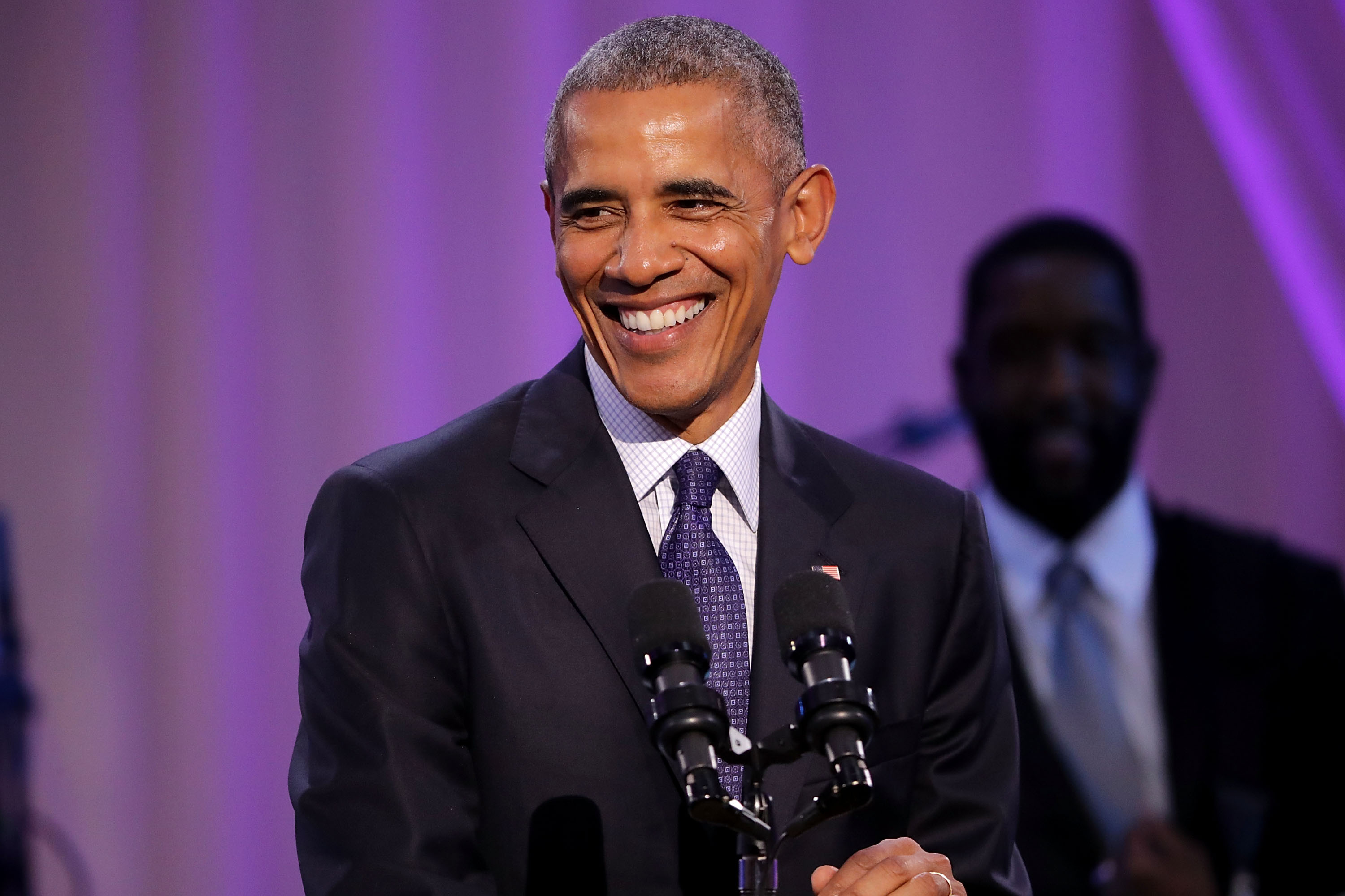 "WASHINGTON, DC - OCTOBER 21:  U.S. President Barack Obama delivers remarks during the BET's 'Love and Happiness: A Musical Experience"" in a tent on the South Lawn of the White House October 21, 2016 in Washington, DC. The show will feature performances by Usher, Jill Scott, Common, The Roots, Bell Biv DeVoe, Janelle Monae, De La Soul, Yolanda Adams, Michelle Williams and Kiki Sheard, along will appearances by actors Samuel L. Jackson, Jesse Williams and Angela Bassett.  (Photo by Chip Somodevilla/Getty Images)"
