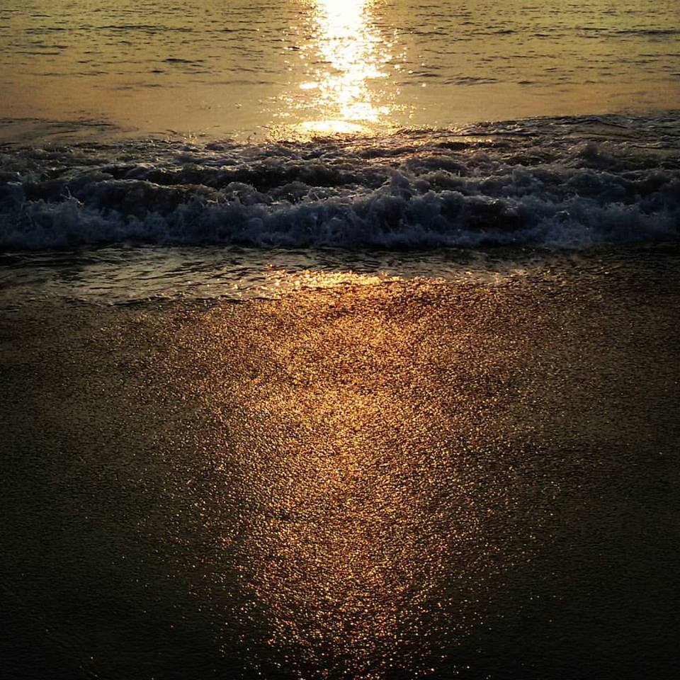Every time I see the sunrise, I am grateful that I am alive. Captured this shimmering golden  sunset in Goa, India.