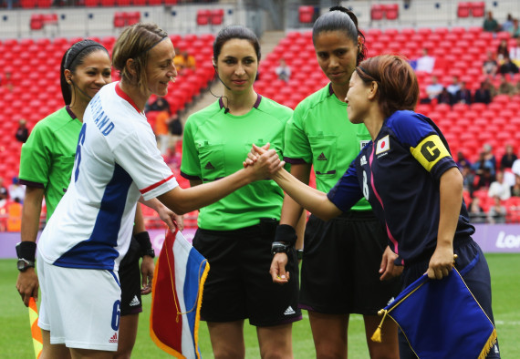 LONDON, ENGLAND - AUGUST 06: Sandrine Soubeyrand (2nd L) of France and Aya Miyama (R) of Japan shake hands prior to the Women's Football Semi Final match between France and Japan on Day 10 of the London 2012 Olympic Games at at Wembley Stadium on August 6, 2012 in London, England.  (Photo by Joern Pollex - FIFA/FIFA via Getty Images)