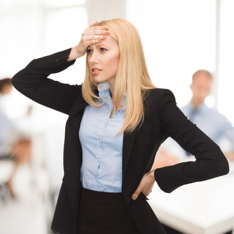 Business woman holding her head