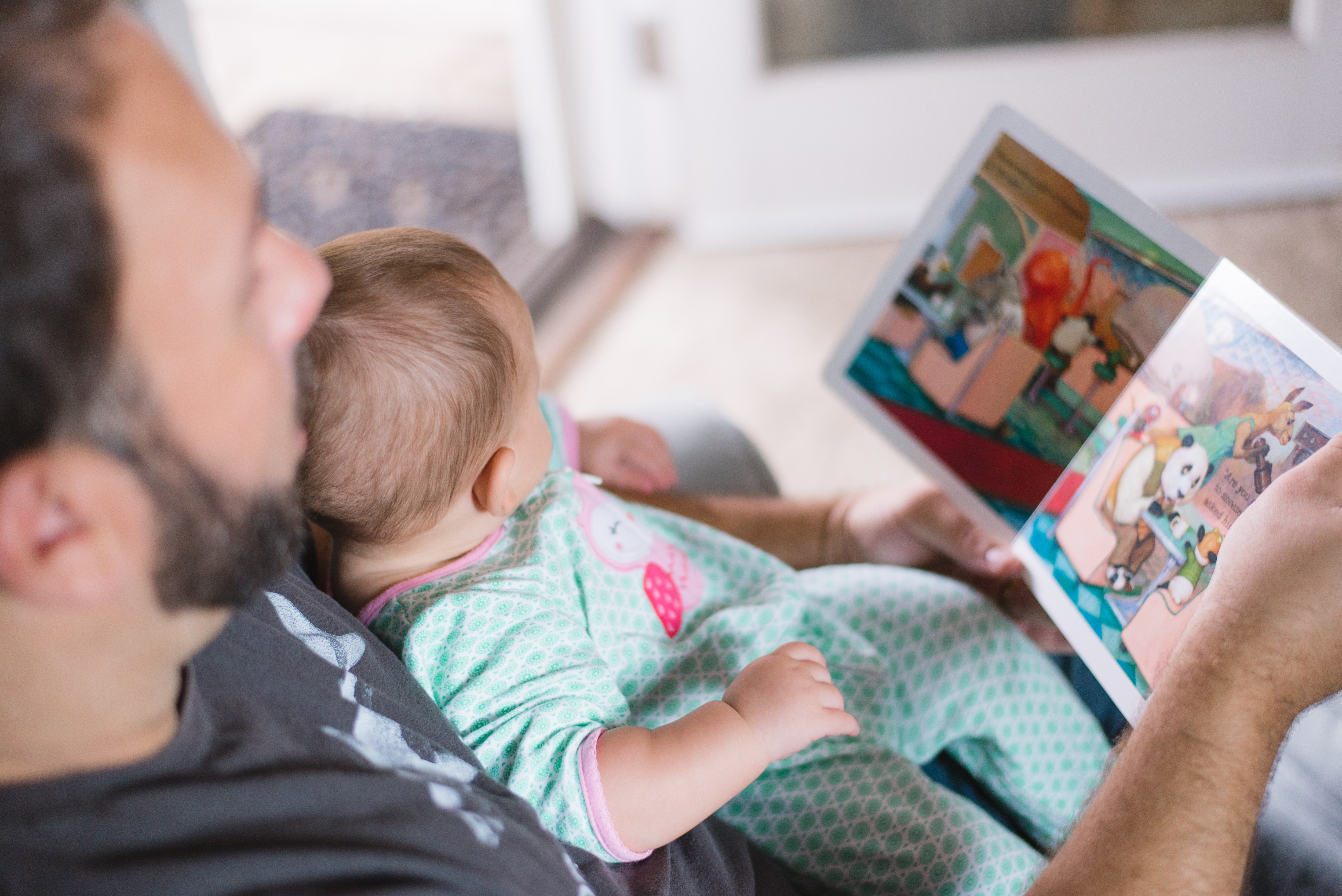 Father reading story to baby