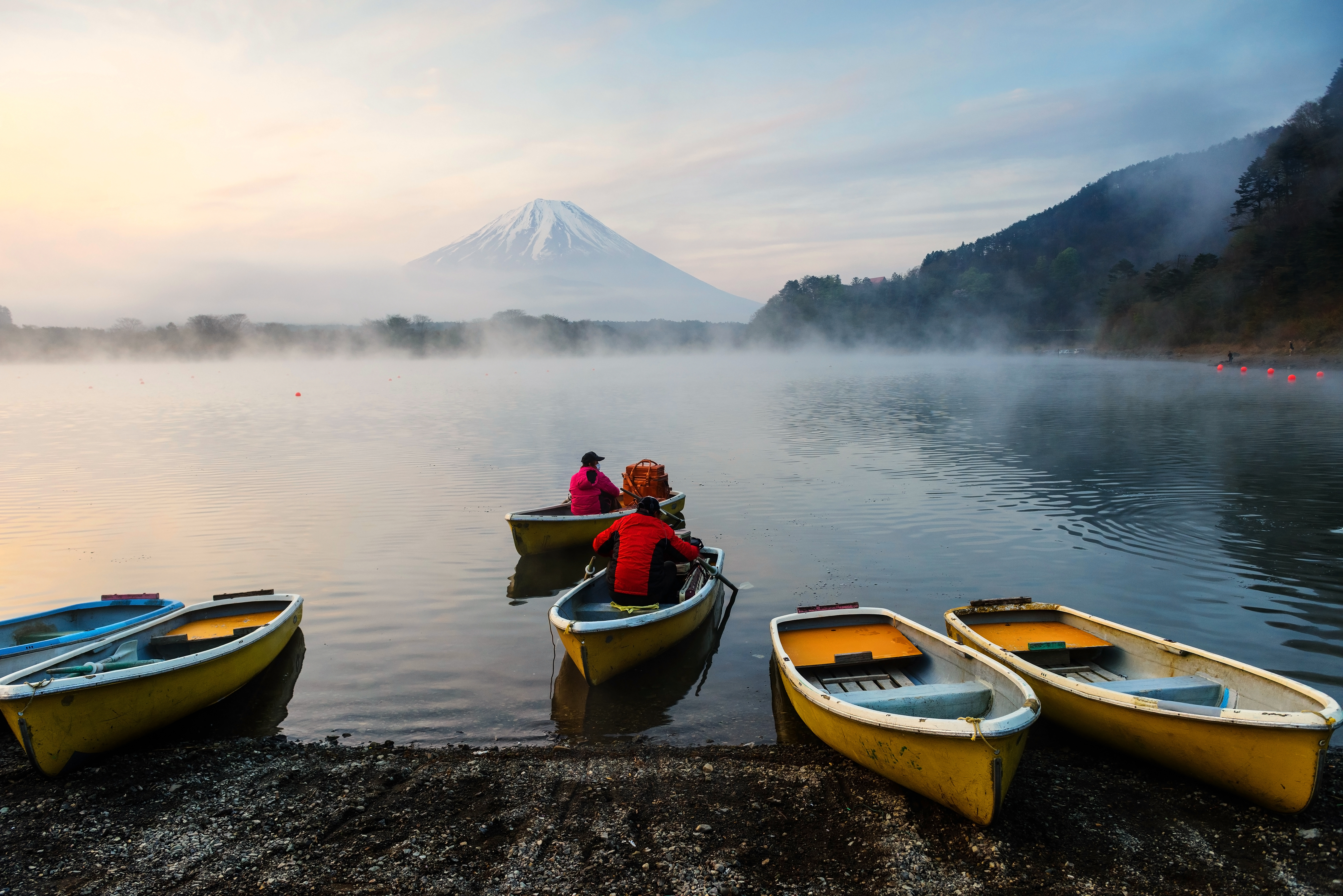 Saling boat for fishing at Lake Shoji in the morning with mist, Japan