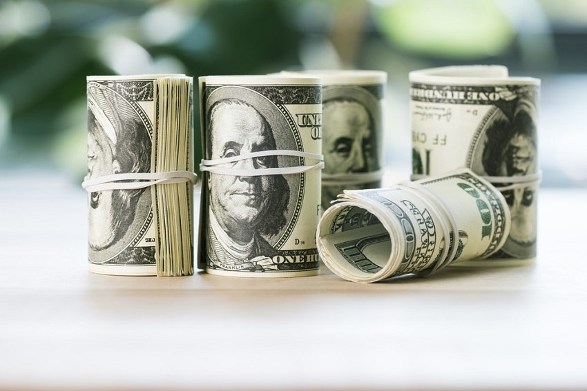 Dollar bills rolled up - an example of what compound interest can do