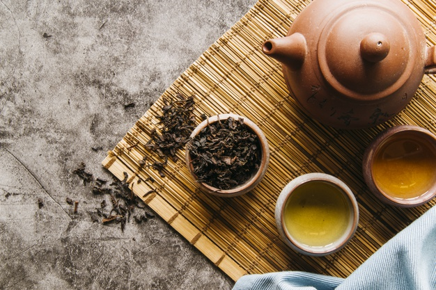 (Source:  https://www.freepik.com/free-photo/dried-tea-leaves-with-teapot-bowl-placemat-concrete-backdrop_5234157.htm)