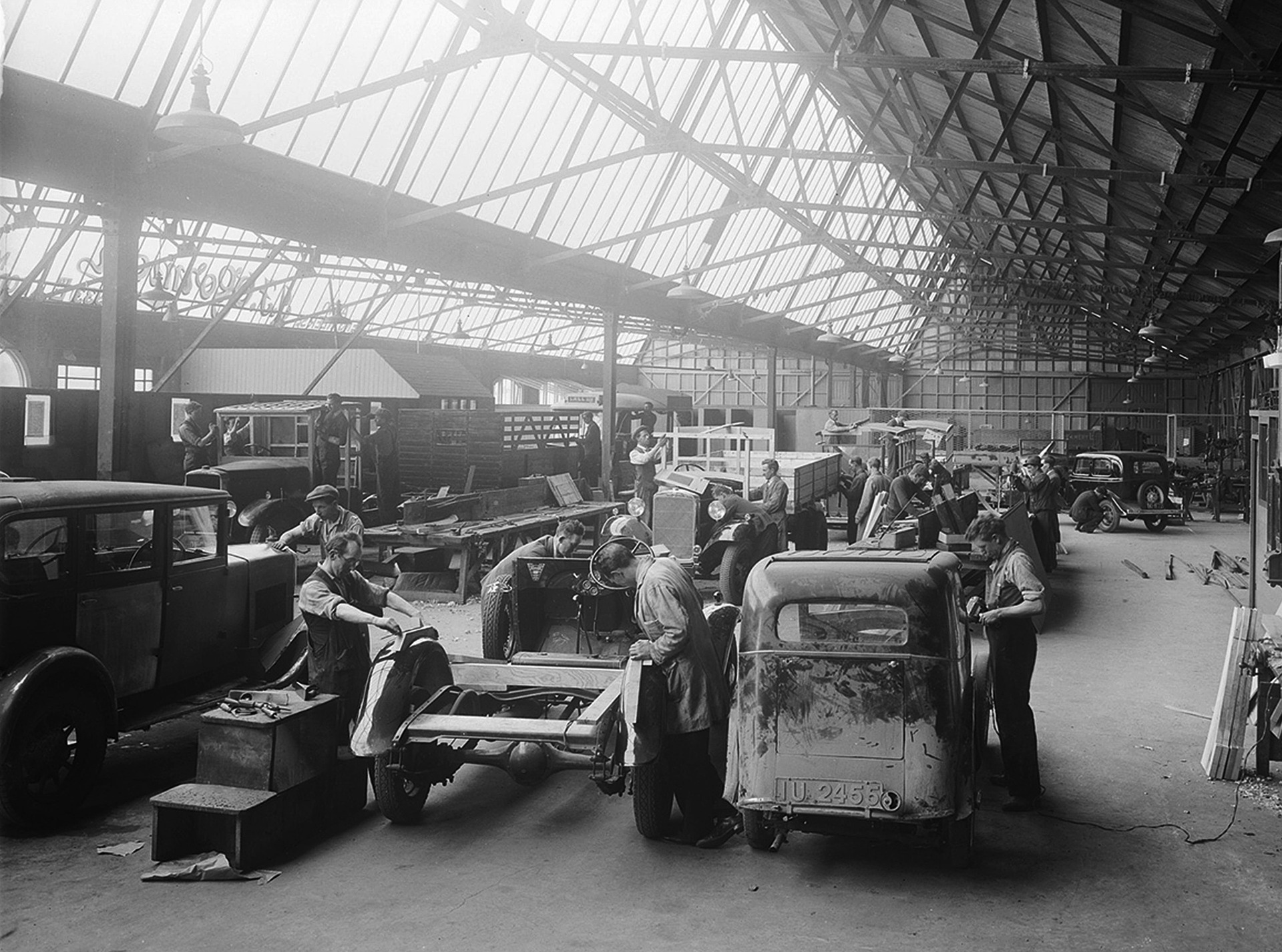 Car production assembly line in the vintage era