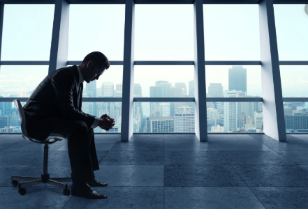 A lonely and disconnected man at his office