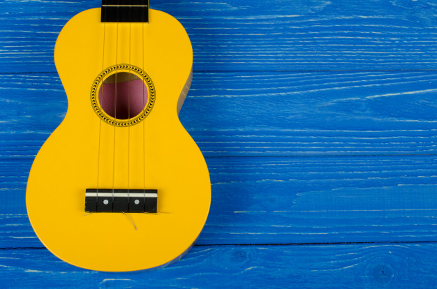 (https://www.freepik.com/premium-photo/yellow-ukulele-guitar-blue-background_5266217.htm)