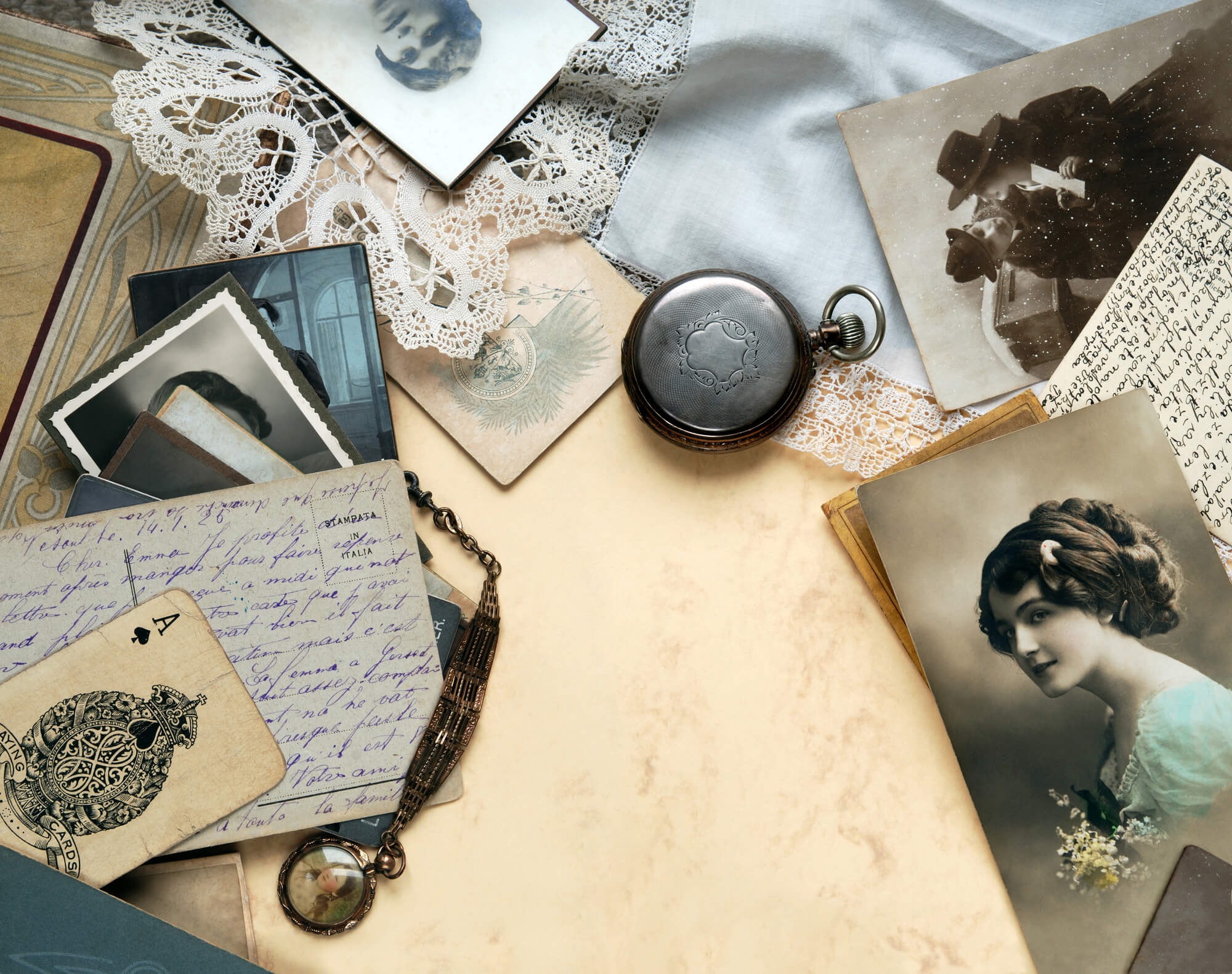 Letters, postcards, pictures, locket, and pocket watch with sentimental attachments