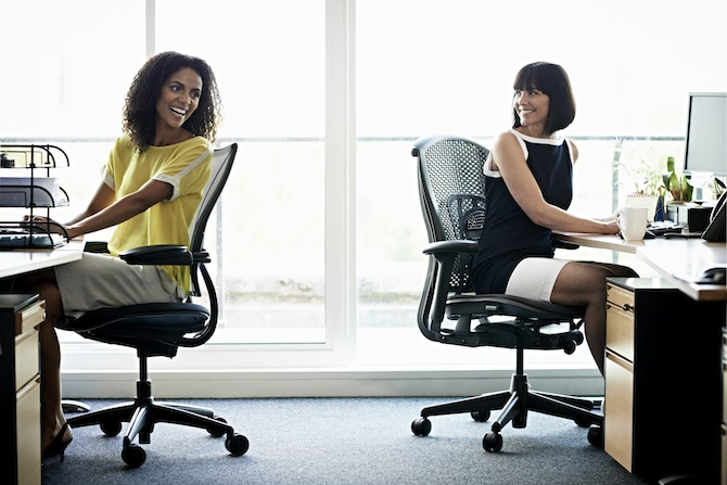 Female coworkers laughing (Source:https://www.canadianbusiness.com/blogs-and-comment/office-friendships-richard-branson/)