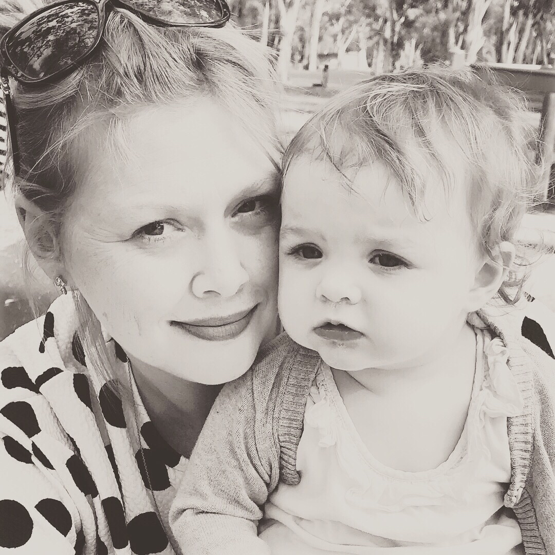 Naomi Lambert, pictured with a baby.