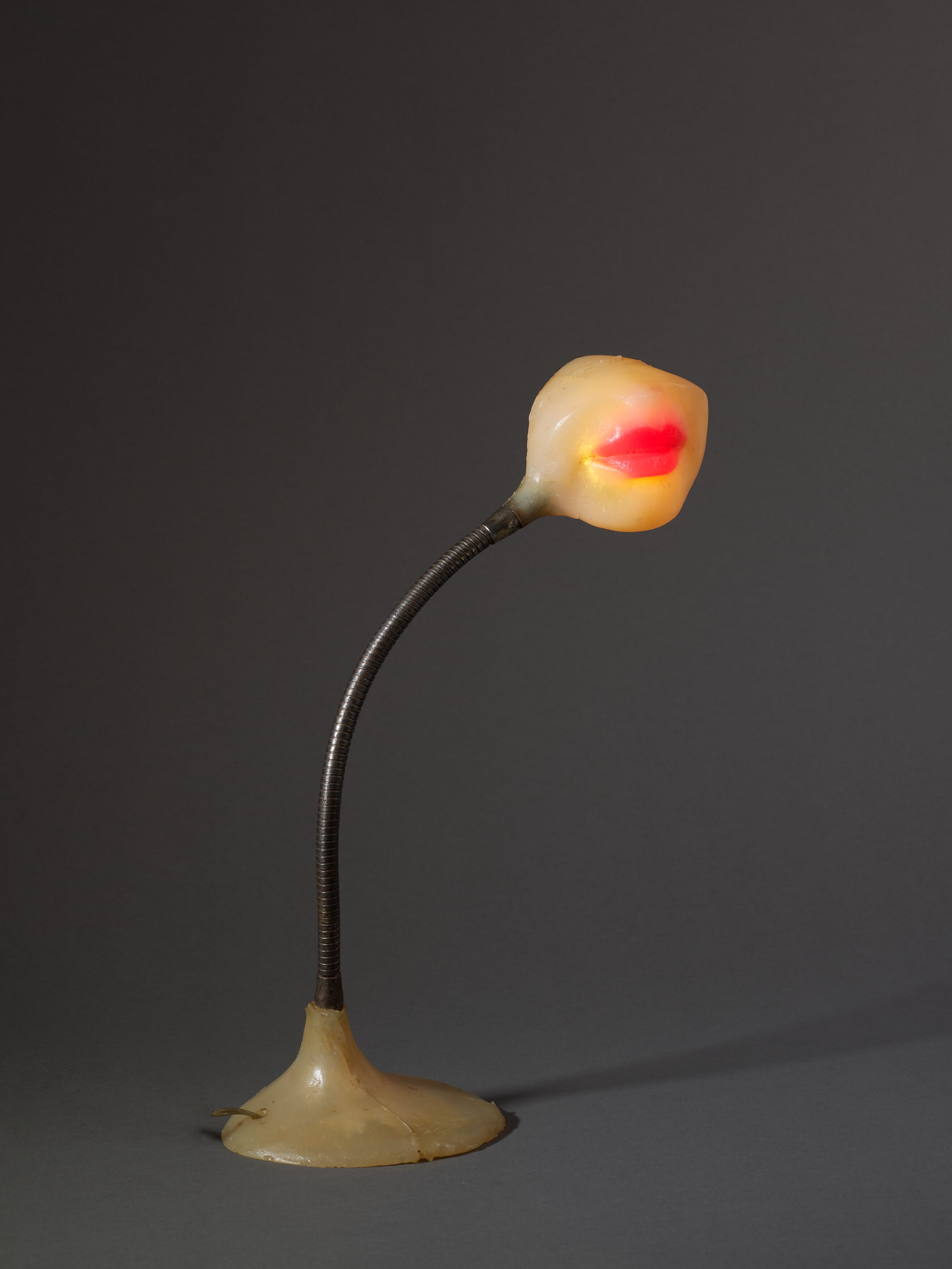 Lampe-bouche (Illuminated Lips) 1966. Colored polyester resin, light bulb, electrical wiring and metal. 43 x 15 x 11 cm / 16 7/8 x 5 7/8 x 4 3/8 in. Photo: Thomas Barratt © ADAGP, Paris. Courtesy the Estate of Alina Szapocznikow / Piotr Stanislawski / Galerie Loevenbruck, Paris / and Hauser & Wirth