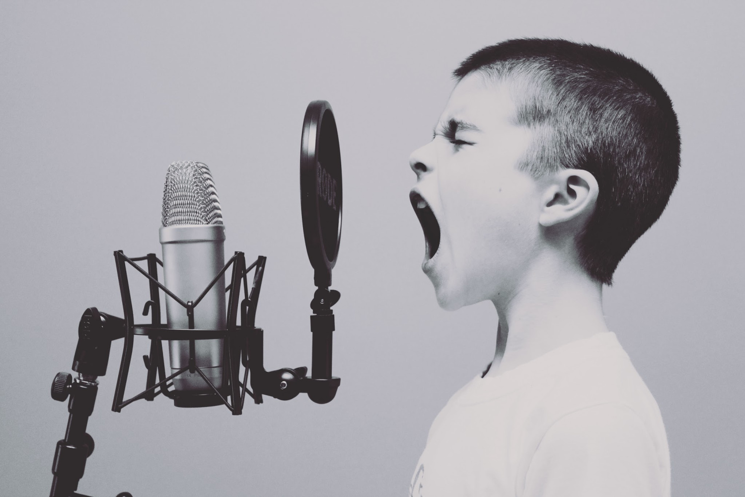 child screaming into a microphone