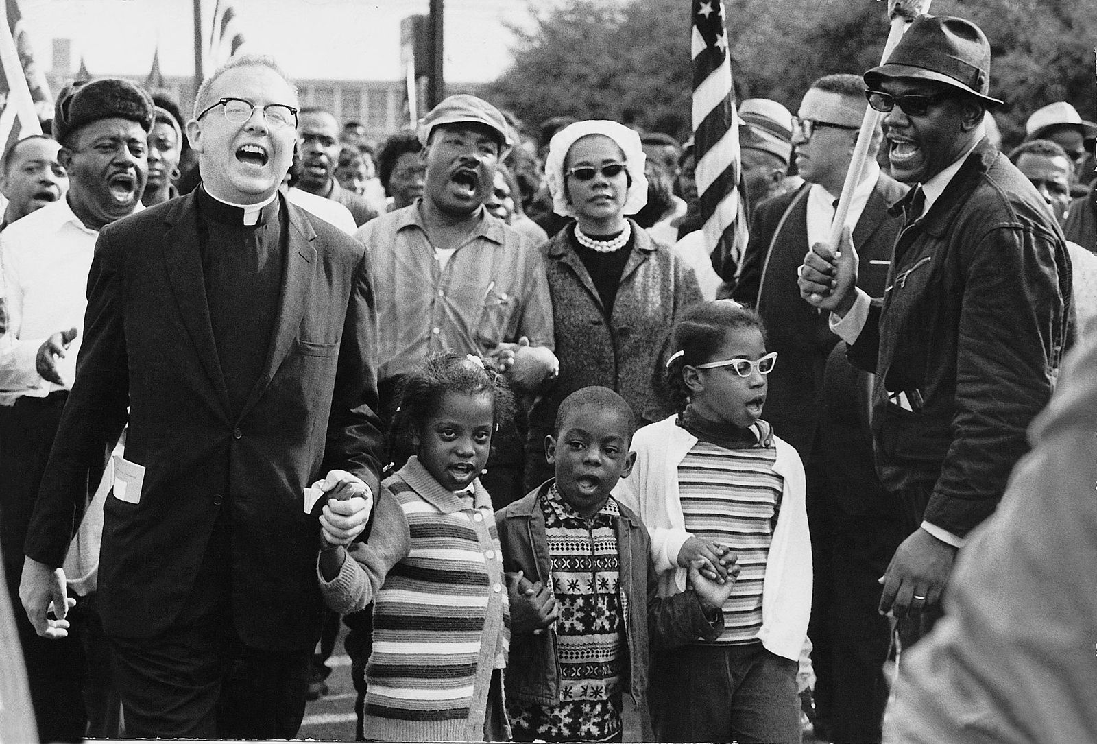 Dr. Ralph David Abernathy and his wife Mrs. Juanita Abernathy and their children with Dr. and Mrs. Martin Luther King march on the front line, leading the SELMA TO MONTGOMERY MARCH in 1965 for voting rights.