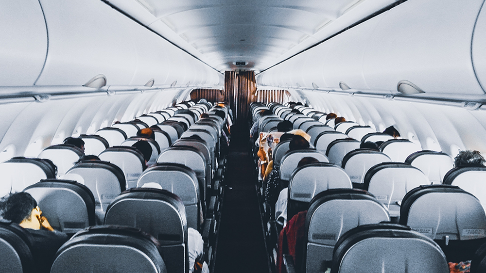 Why Being Lost Is So Good for You, image of the inside of an airplane seating and people in the seats