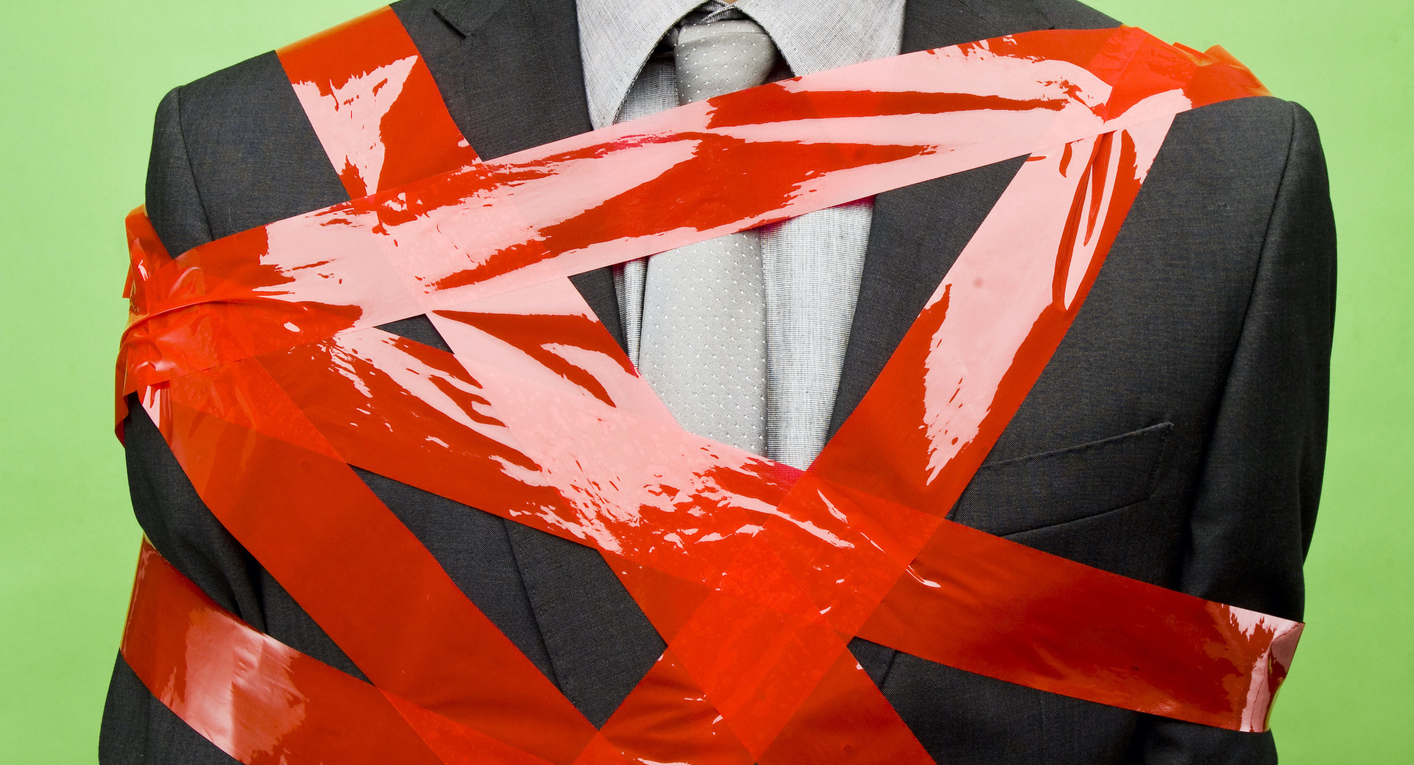 Red Tape on Businessman