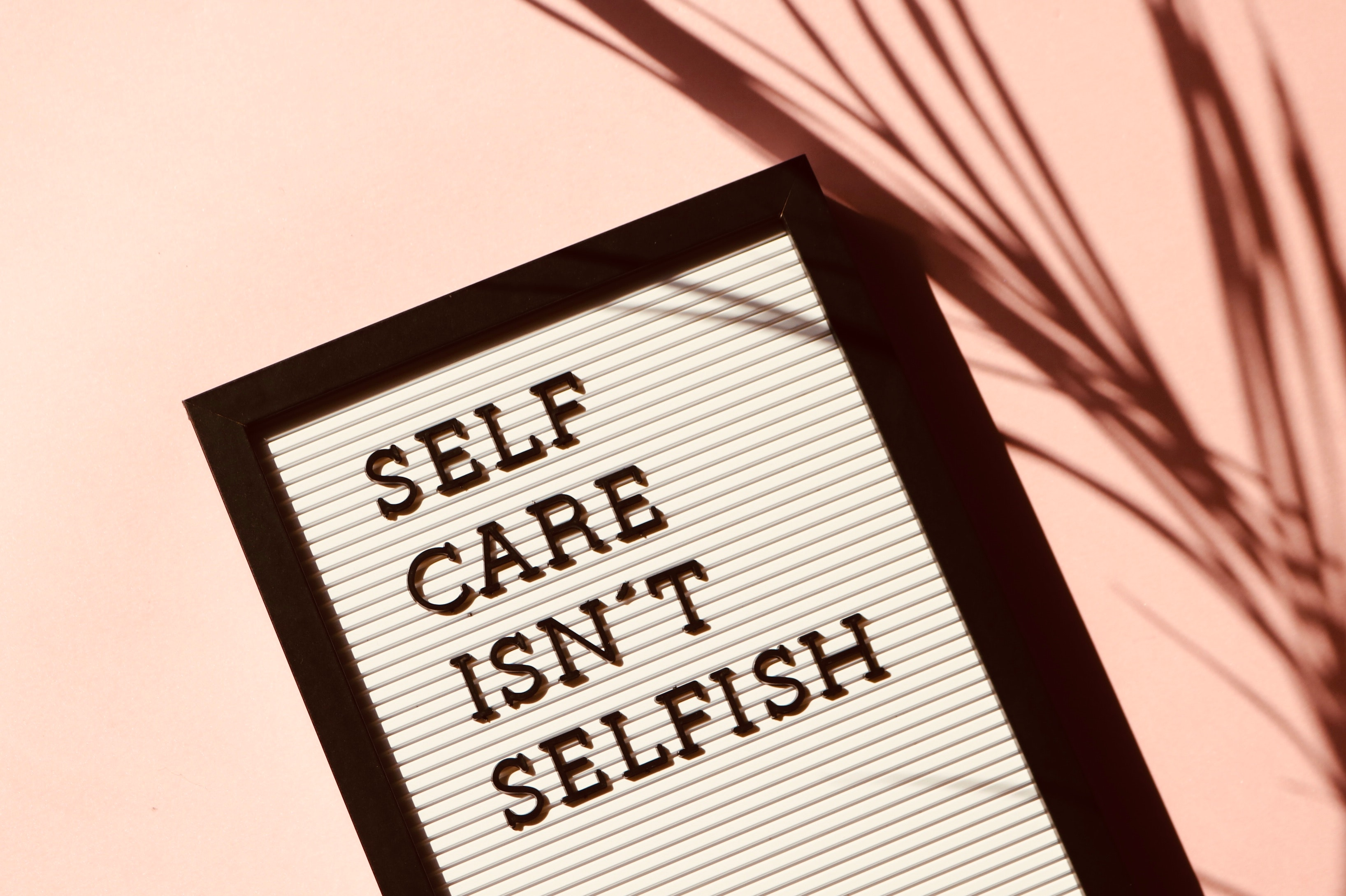 Have a Little Compassion, Will You?, Image of a sign board saying self care isn't selfish