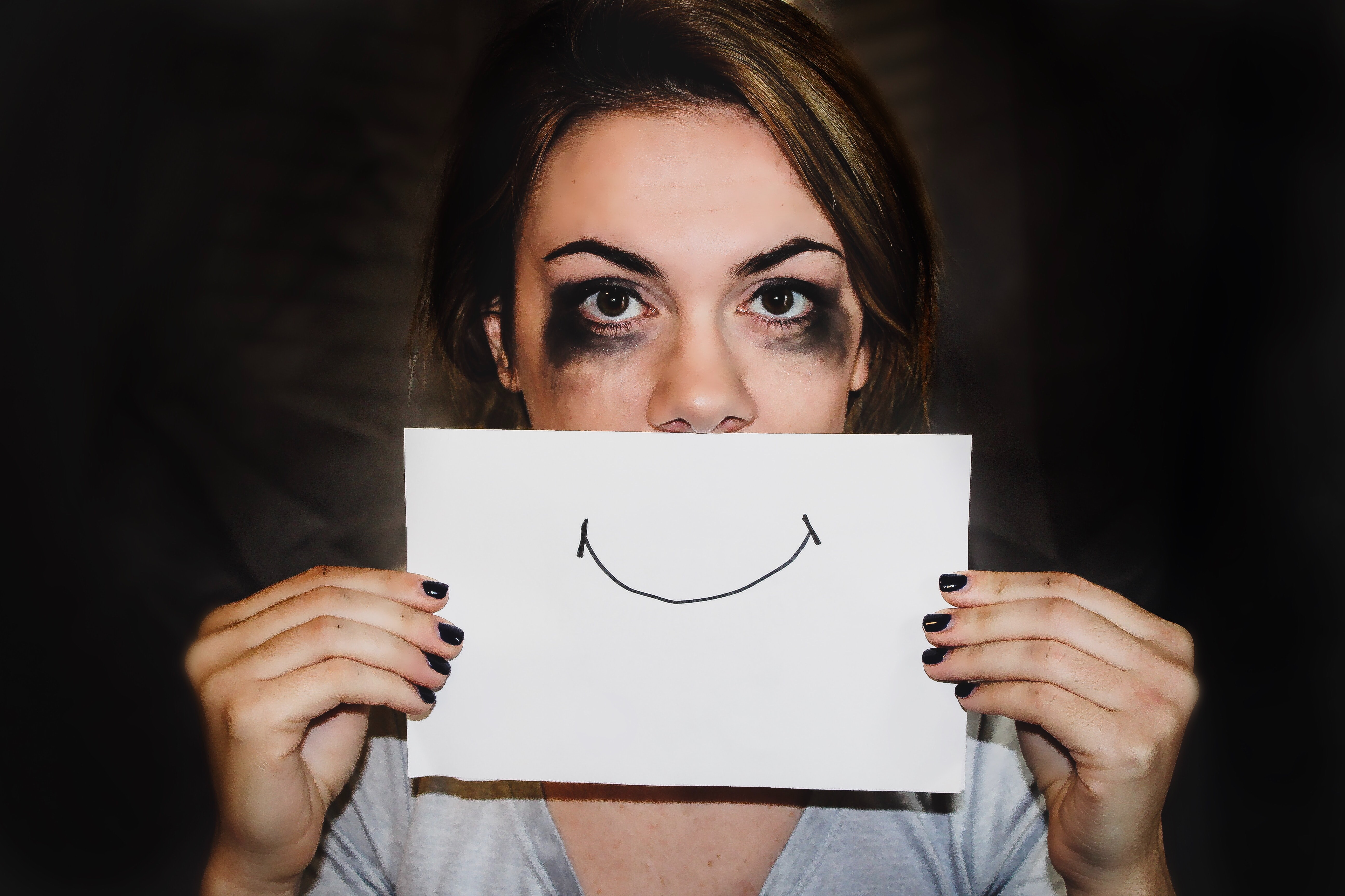 Woman holding paper with smile on
