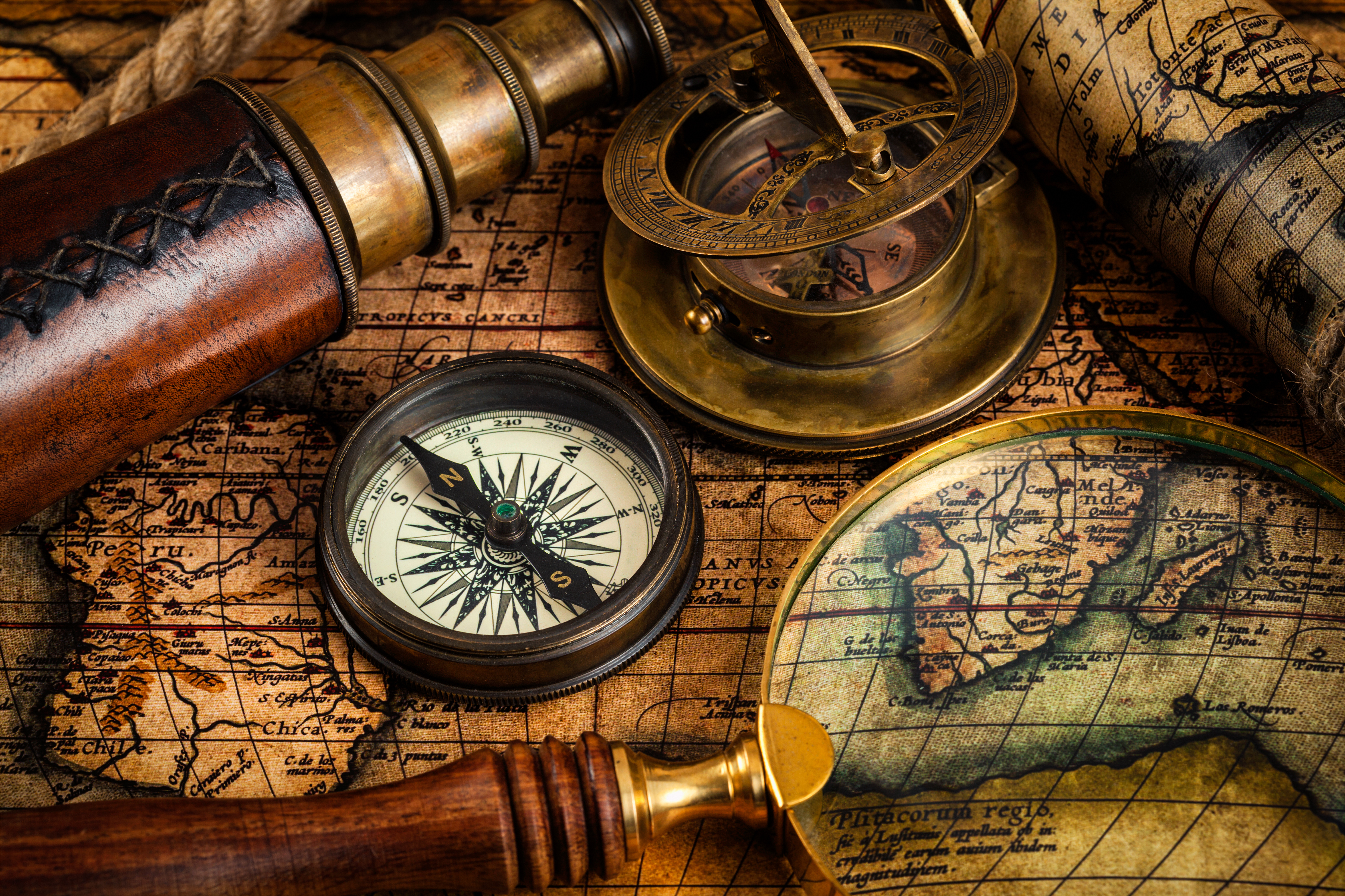 Old vintage compass and travel instruments on ancient map (iStock)