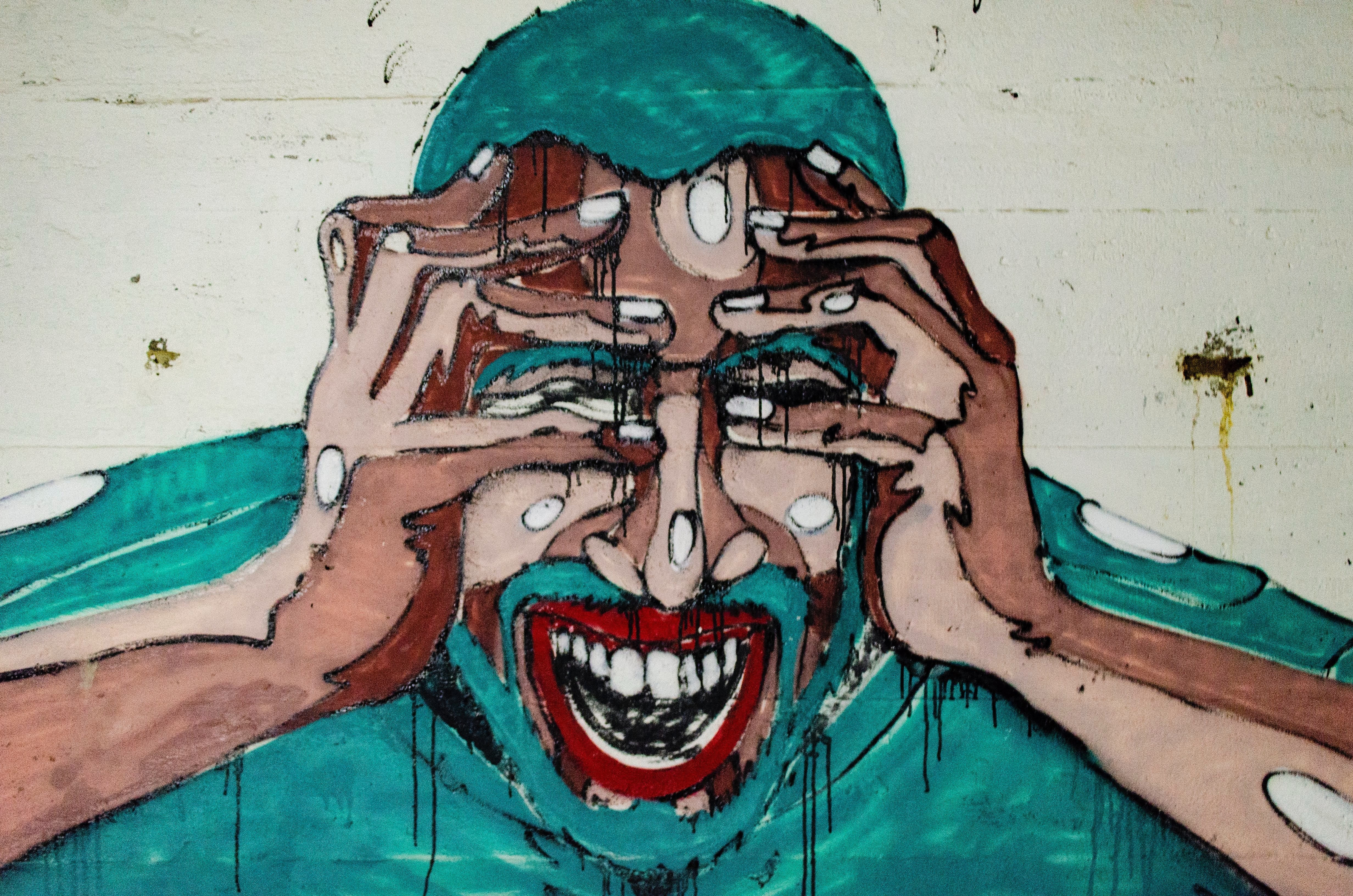 painting of man covering face with both hands