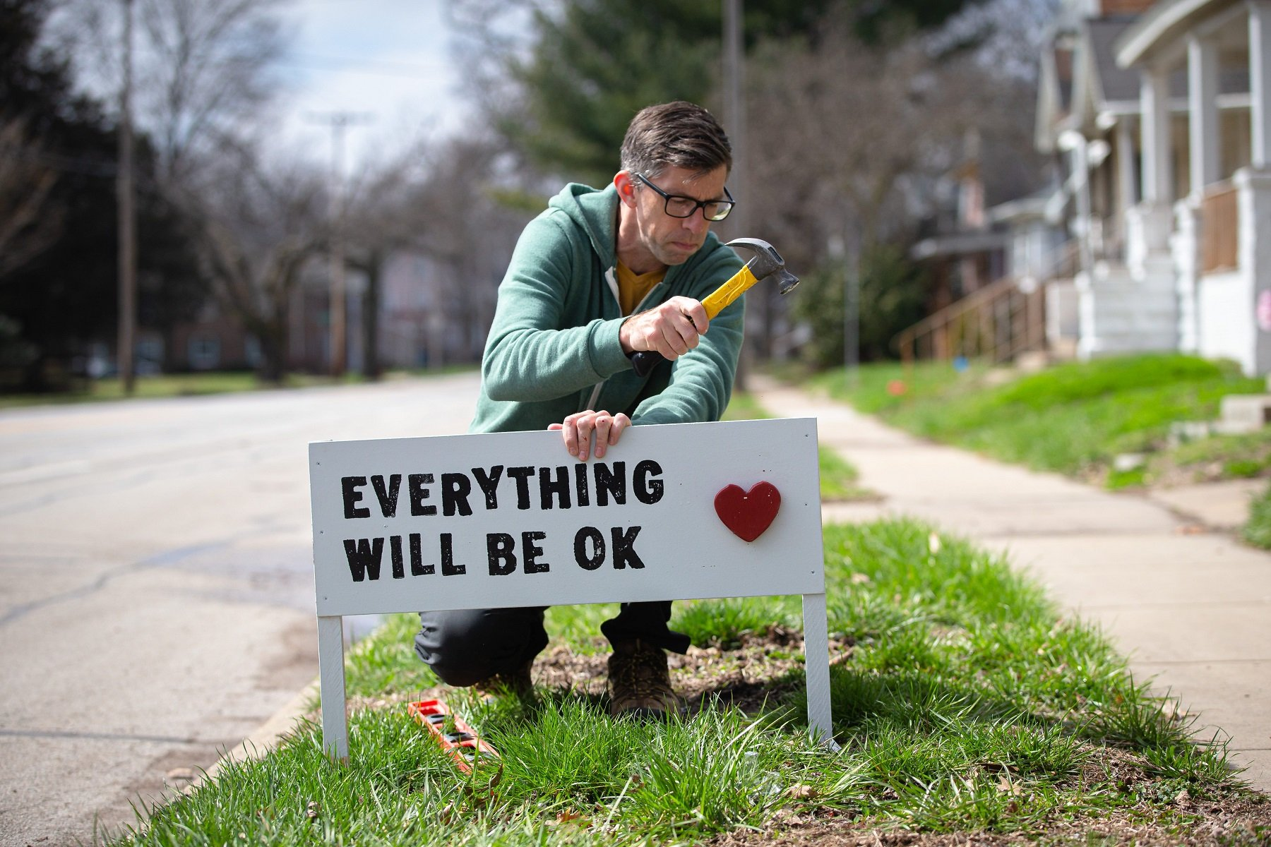 "Dave Heinzel installs one of his handmade signs with the saying ""Everything Will Be Ok"" along with a 3D red heart that he he handmade in response to the COVID-19 pandemic in front of a home on West Lawrence Avenue, Wednesday, March 25, 2020, in Springfield, Ill. Heinzel started taking requests for the signs on social media and the demand soared to over 200 requests. ""I really think everything will be okay,"" said Heinzel. ""It's going to get worse and it's not going to be fun and we're going to lose people we know, but it will be okay.""Usp News Coronavirus A Usa Il"