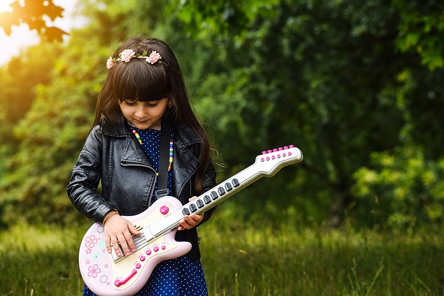 A child with a guitar