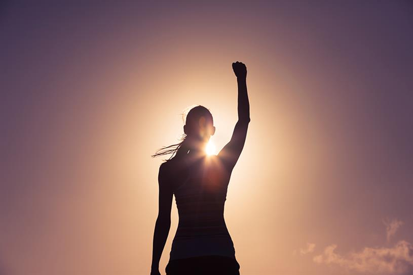 Woman raising fist