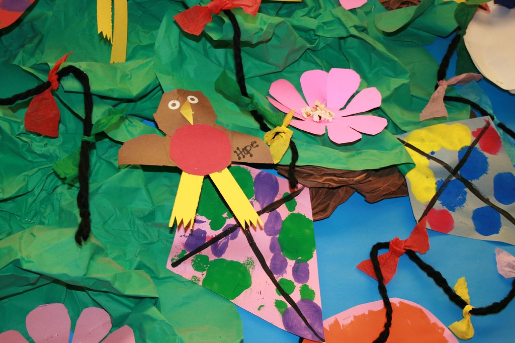 A child's collage of birds and flowers.