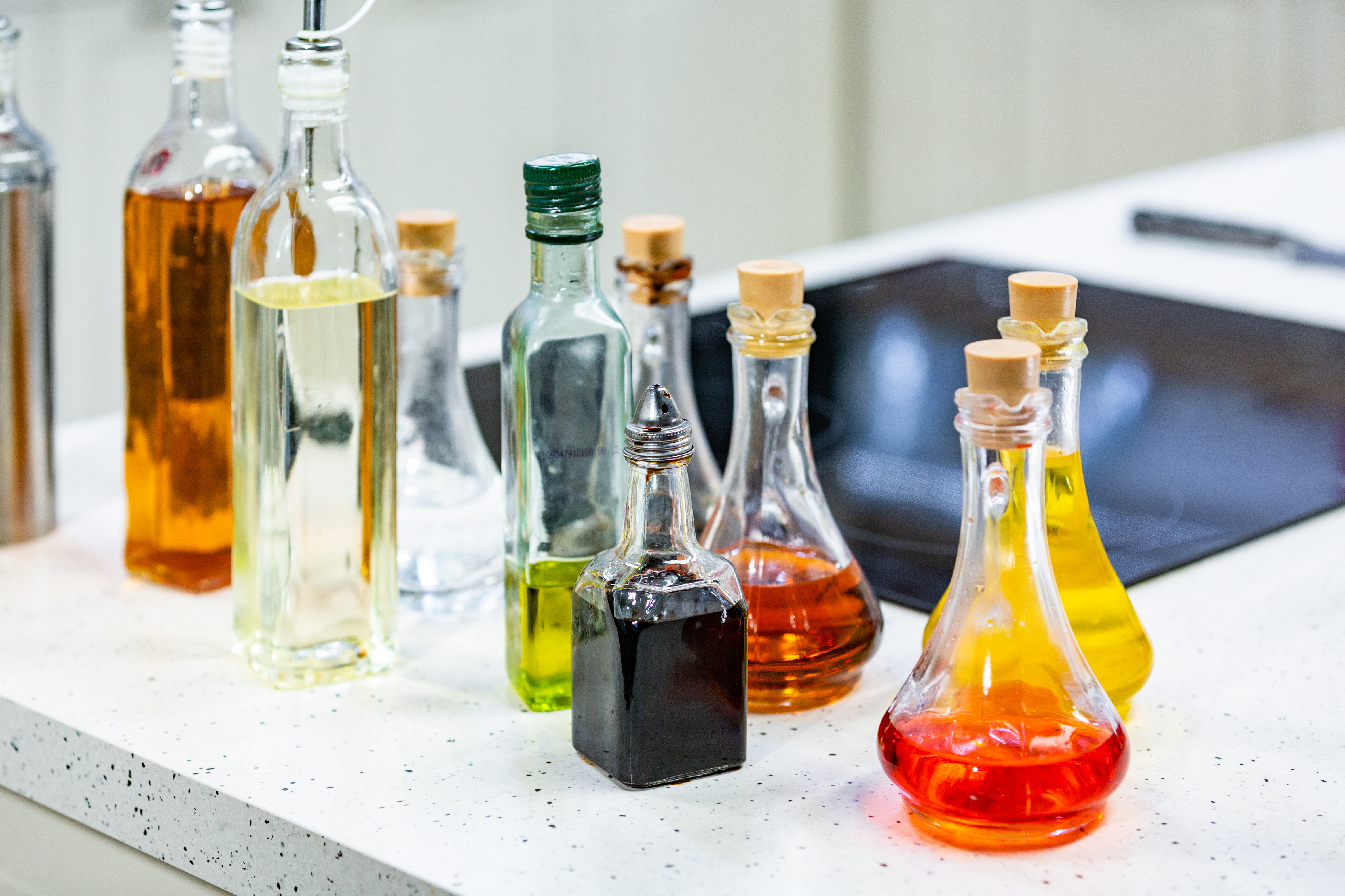 Small bottles of flavored olive oil and balsamic vinegar in the kitchen.