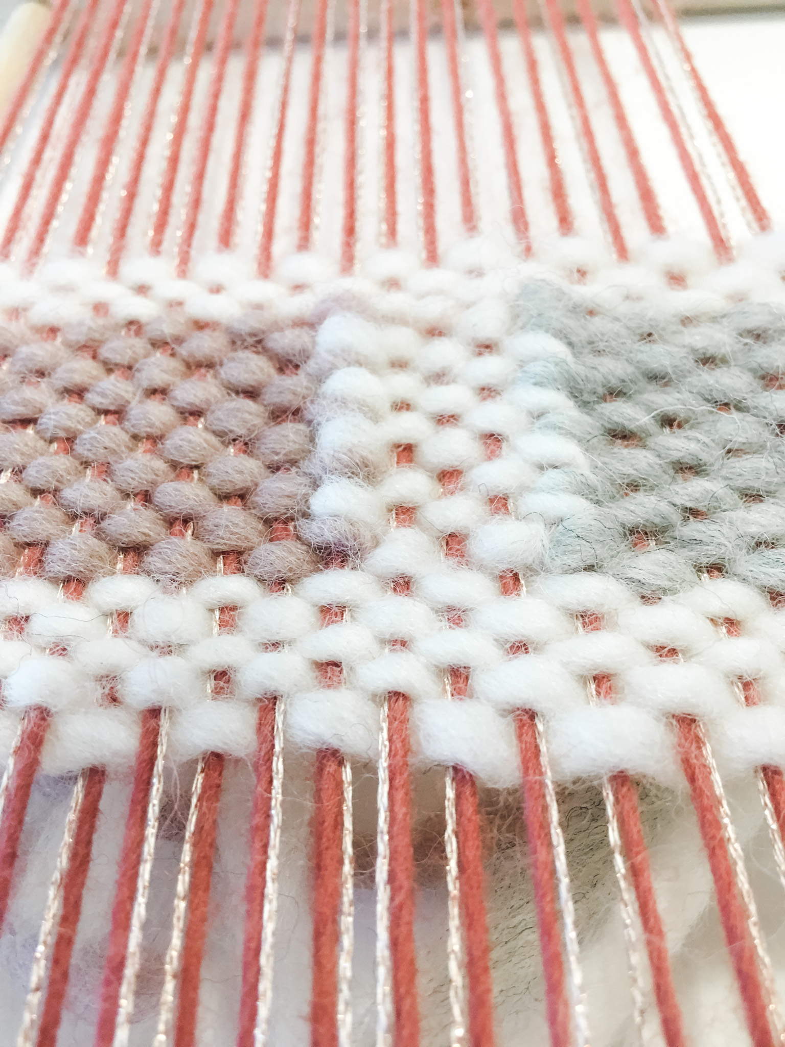 Weaving squares on the loom.