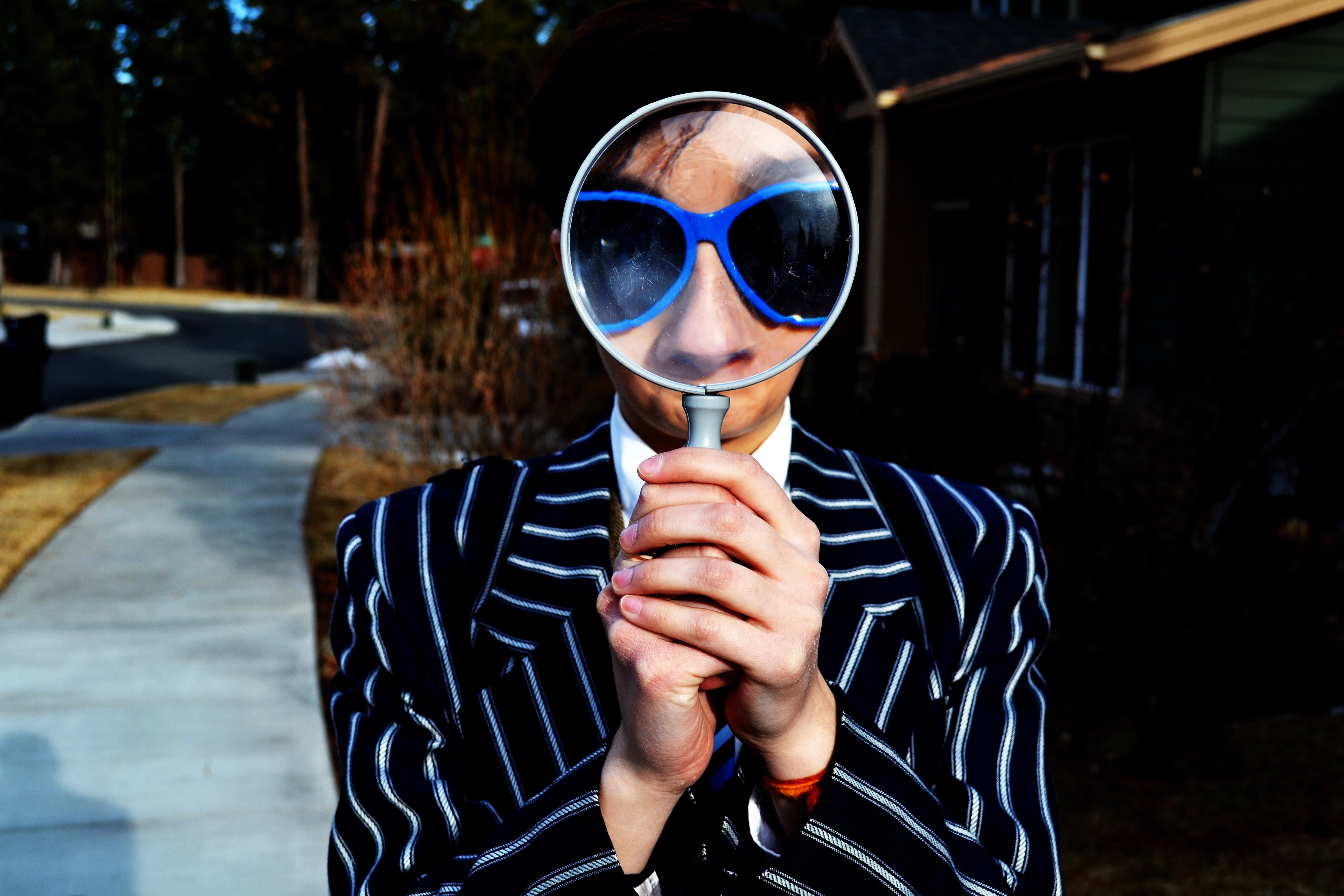 person looking through magnifying glasses